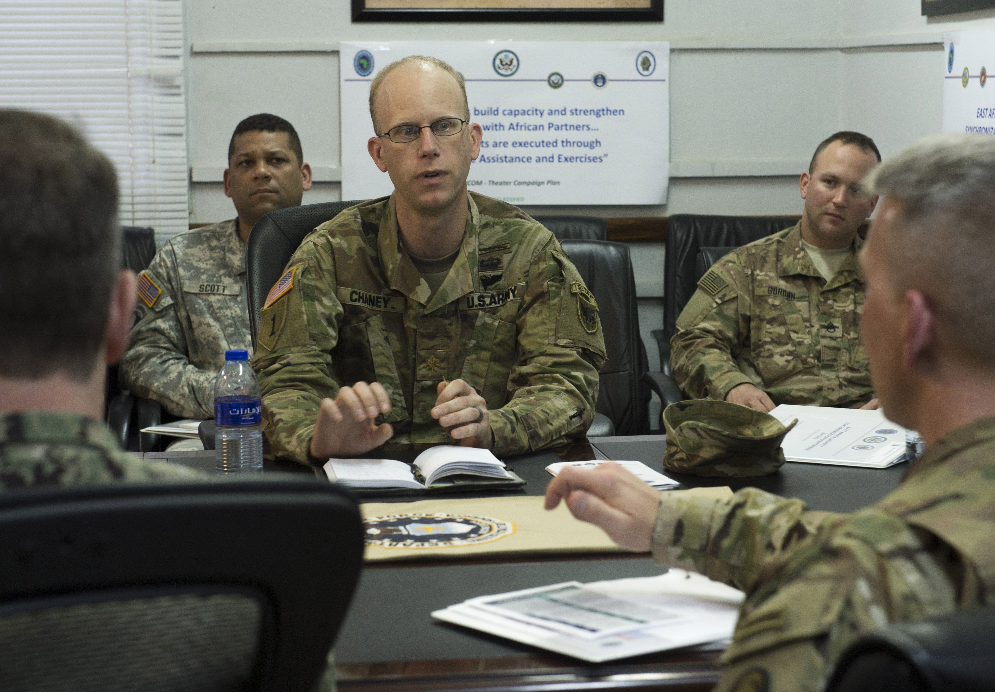 Military members in a working group discuss Africa Contingency Operations Training and Assistance during the East Africa Security Synchronization Conference Jan. 21, 2016, at Camp Lemonnier, Djibouti. More than 70 U.S. embassy representatives from each East African country and organizations including the African Union, U.S. Africa Command, and AFRICOM components attended the event to kick start the process of synchronizing and prioritizing all activities in East Africa. (U.S. Air Force photo by Senior Airman Peter Thompson)