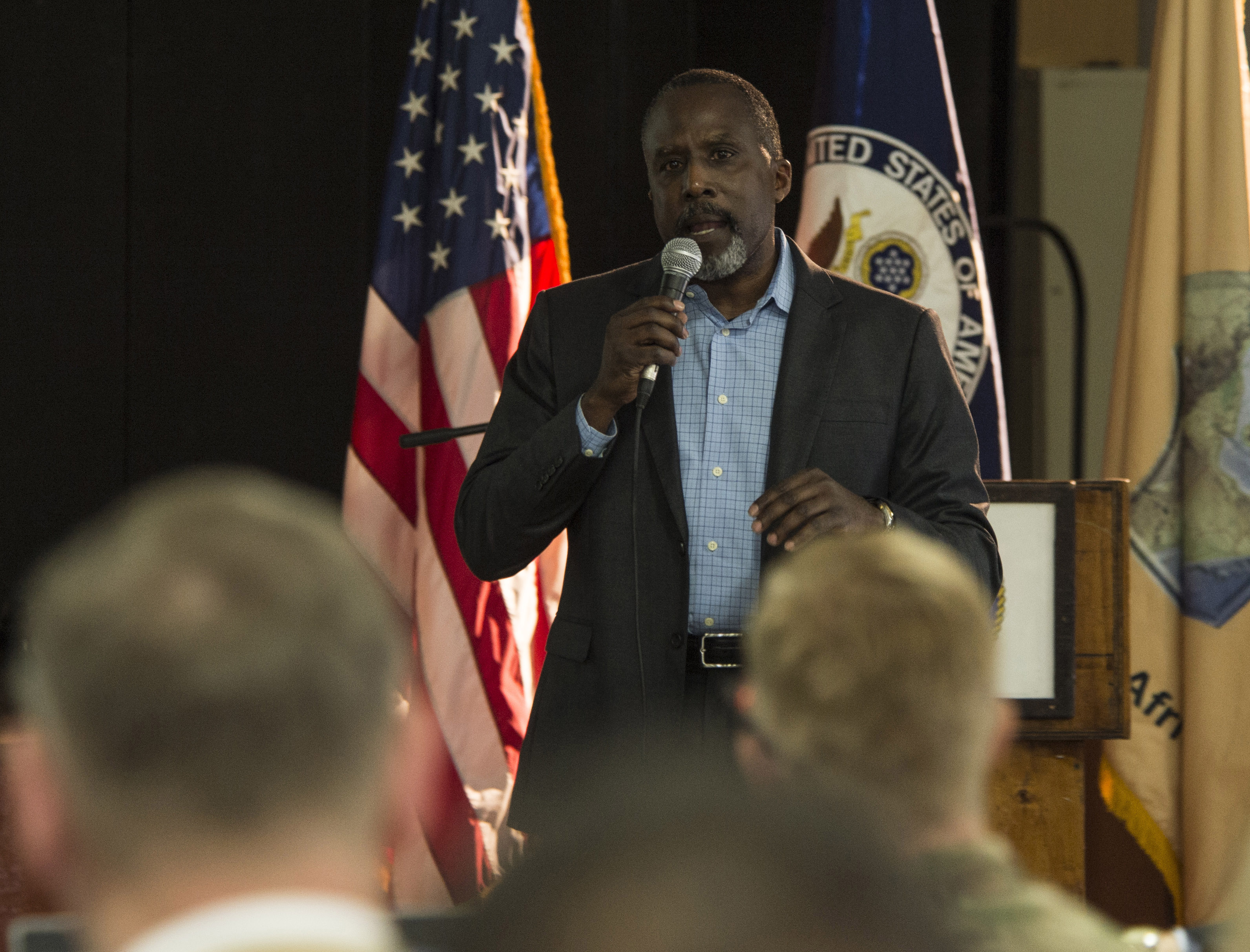 Victor John, Africa Contingency Operations Training and Assistance program operations manager, speaks to audience members during the East Africa Security Synchronization Conference Jan. 20, 2016, at Camp Lemonnier, Djibouti. More than 70 U.S. embassy representatives from each East African country and organizations including the African Union, U.S. Africa Command, and AFRICOM components attended the event to kick start the process of synchronizing and prioritizing all activities in East Africa. (U.S. Air Force photo by Senior Airman Peter Thompson)