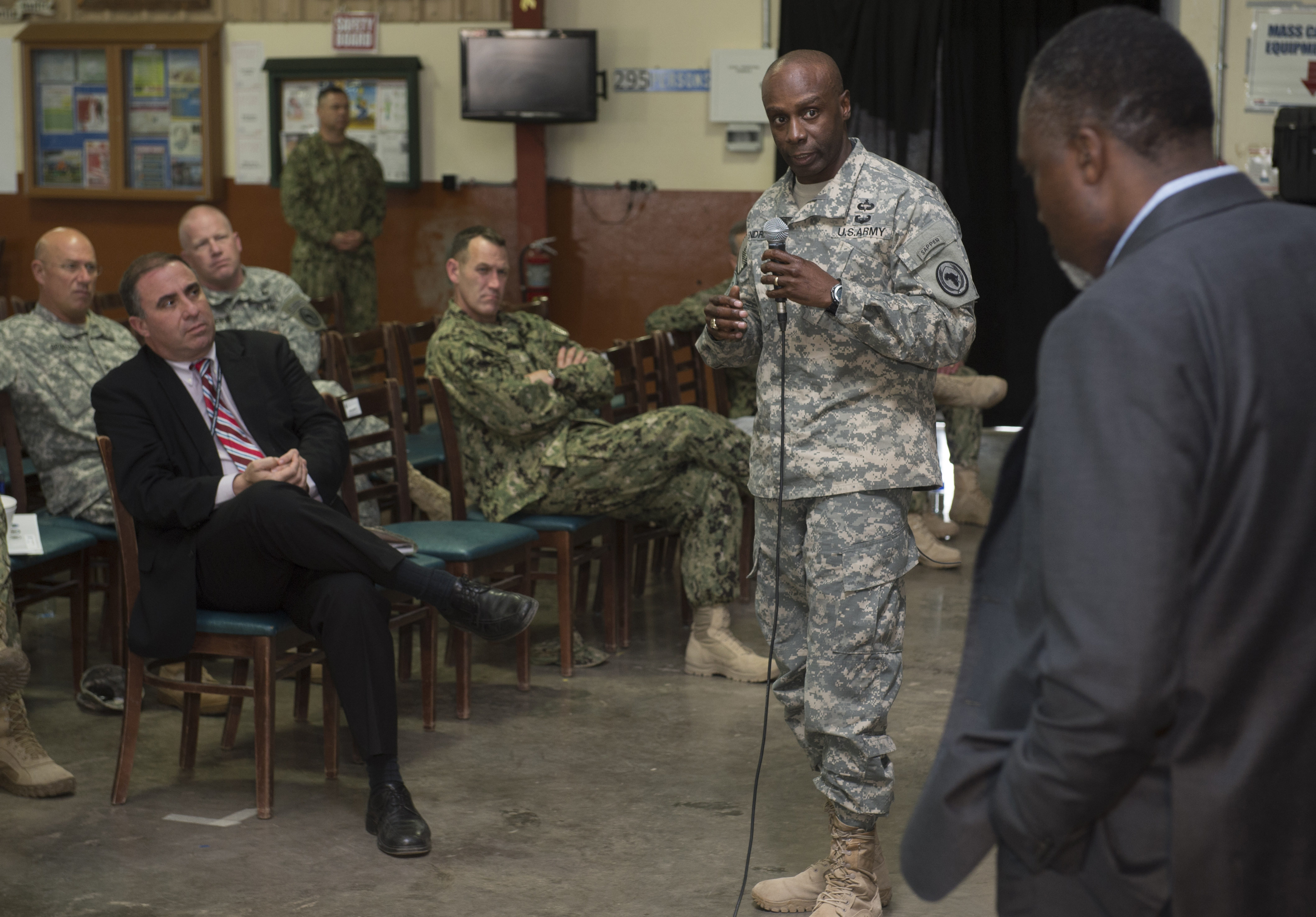 Command Sgt. Maj. Butler Kendrick Jr., Combined Joint Task Force-Horn of Africa senior enlisted leader, discusses a topic with members of the East Africa Security Synchronization Conference Jan. 20, 2016, at Camp Lemonnier, Djibouti. The EASSC is the only conference between U.S. Department of State and U.S. military representatives dedicated to aligning military and political priorities for East Africa. (U.S. Air Force photo by Senior Airman Peter Thompson)