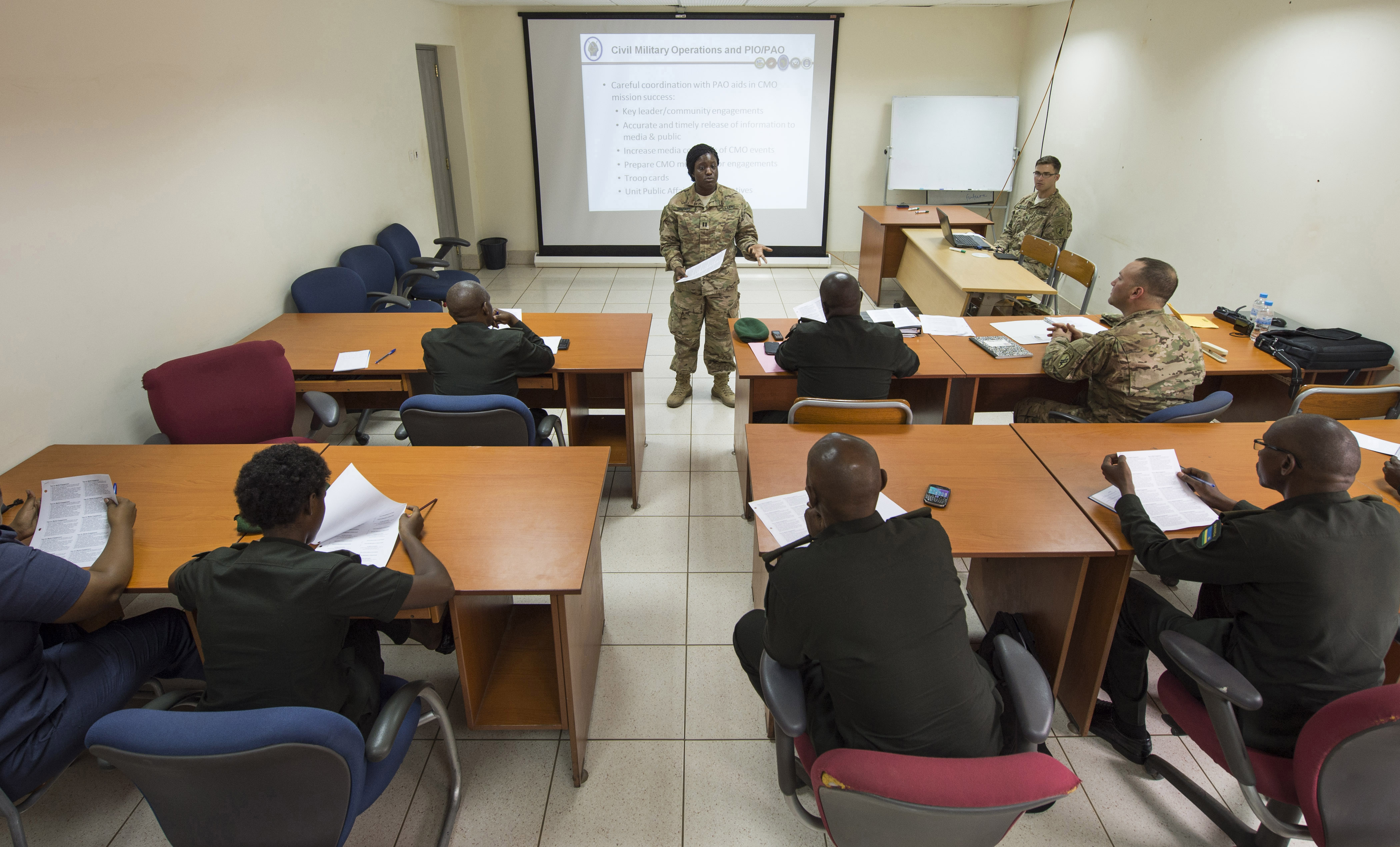 U.S. Army Capt. Morgan Shepard, Combined Joint Task Force-Horn of Africa Public Information officer, discusses civil military operations and the roles of Public Affairs and Public Information Officers Feb. 2, 2016, at RDF headquarters, Kigali, Rwanda. During the engagement, U.S. Army civil affairs and Rwanda Defense Force Civil Military Co-operation (CIMIC) discussed similarities and differences between the organizations. The RDF will use the knowledge gained during the event to address training and organizational needs for their forces. (U.S. Air Force photo by Senior Airman Peter Thompson)