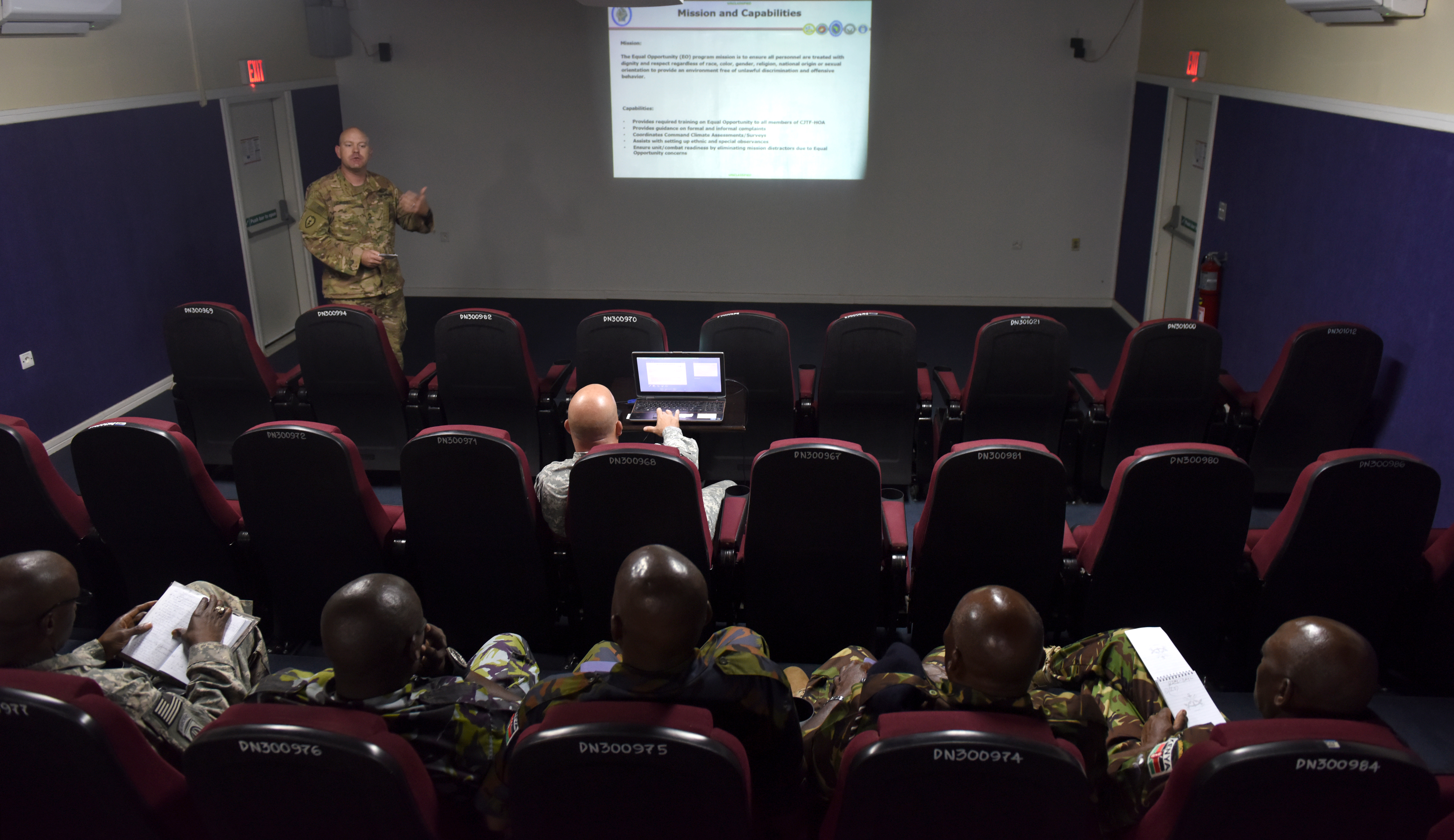 Senior enlisted leaders from the Kenya Defence Forces attend an Equal Opportunity brief at Camp Lemonnier, Djibouti, during an SEL engagement Feb. 11, 2016. The briefings focused on operations and how Combined Joint Task Force-Horn of Africa personnel accomplish the mission successfully, including equality and troop welfare. (U.S. Air Force photo by Staff Sgt. Kate Thornton)