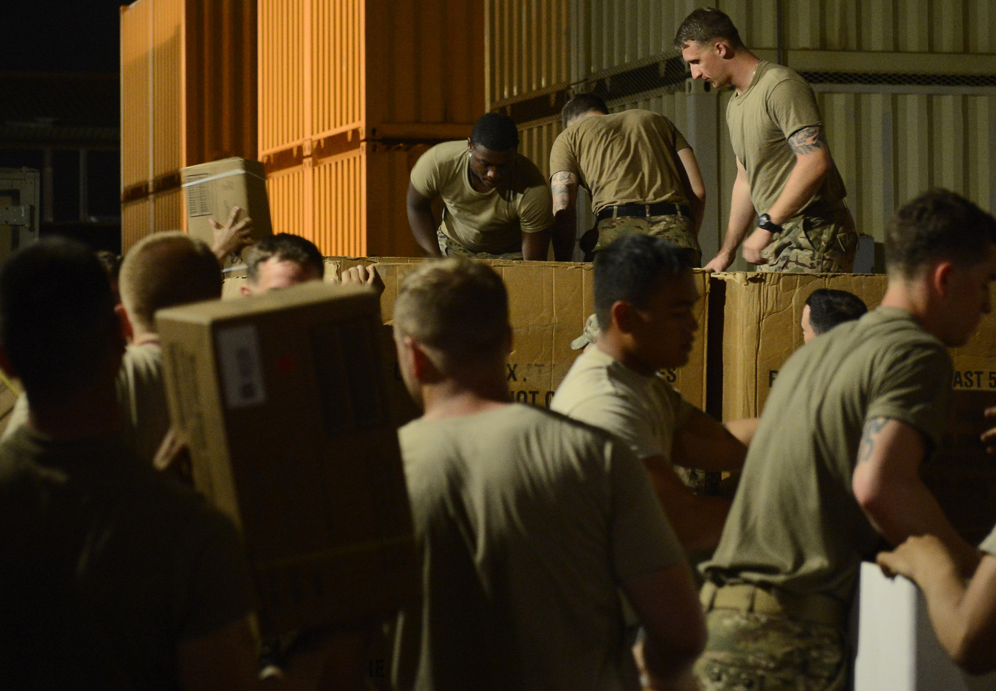 Soldiers from Bravo Company, 3rd Battalion, 15th Infantry Regiment, load pallets with water and meals ready-to-eat Feb. 13, 2016, at Camp Lemonnier, Djibouti. Members of Bravo Company participated in a two-part validation exercise that consisted of a rapid mobilization scenario from the camp, which lead to the company convoying to and providing security for the U.S. Embassy in Djibouti. (U.S. Air Force photo by Senior Airman Peter Thompson)
