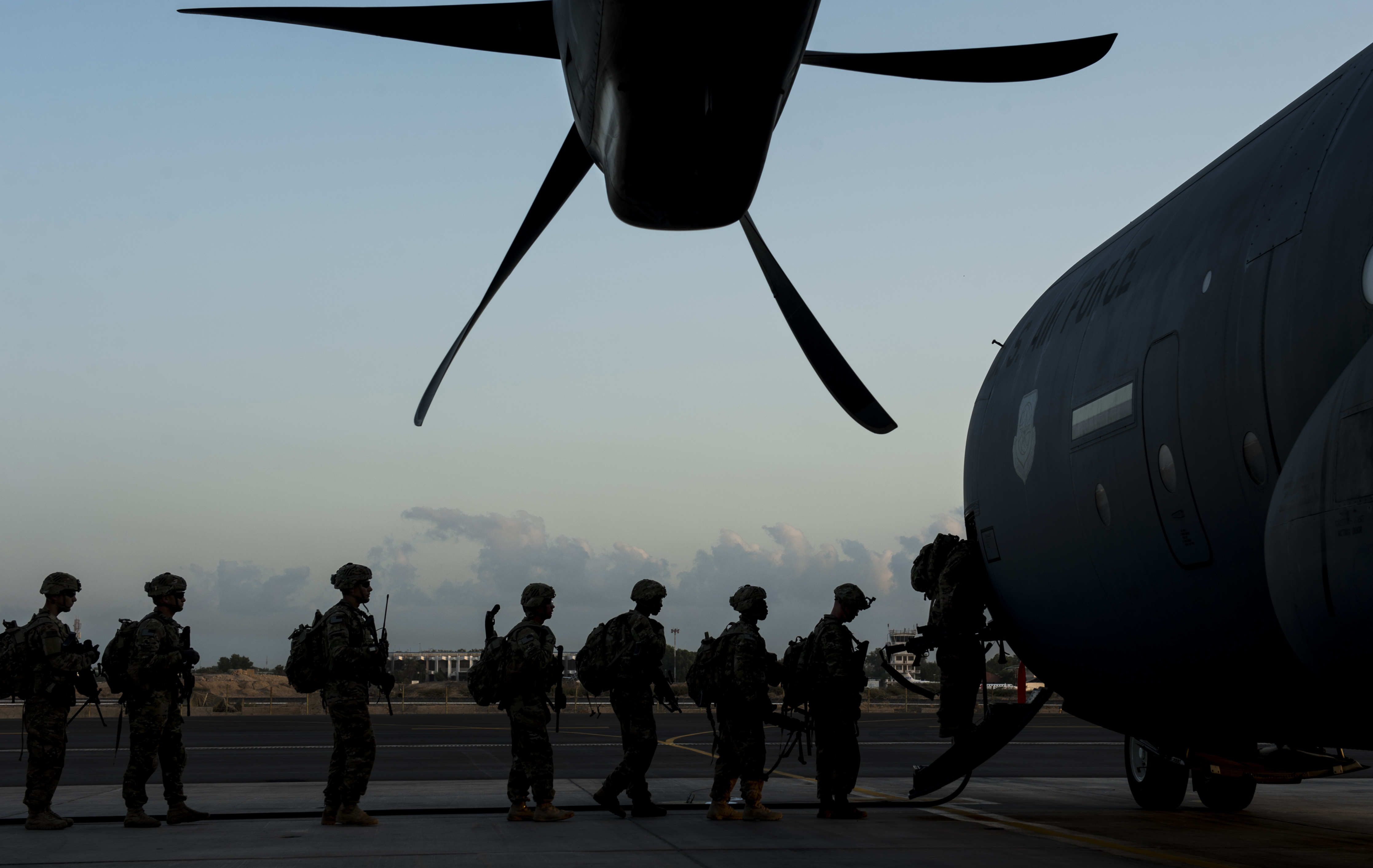 Soldiers from Bravo Company, 3rd Battalion, 15th Infantry Regiment, board a C-130J Super Hercules assigned to the 75th Expeditionary Airlift Squadron Feb. 13, 2016, at Camp Lemonnier, Djibouti. Members of the U.S. Army's Bravo Company 3-15, from Fort Stewart, Georgia, completed a validation exercise displaying their ability to assume responsibility from Alpha Company 3-15, as the East Africa Response Force assigned to Combined Joint Task Force-Horn of Africa. (U.S. Air Force photo by Senior Airman Peter Thompson)