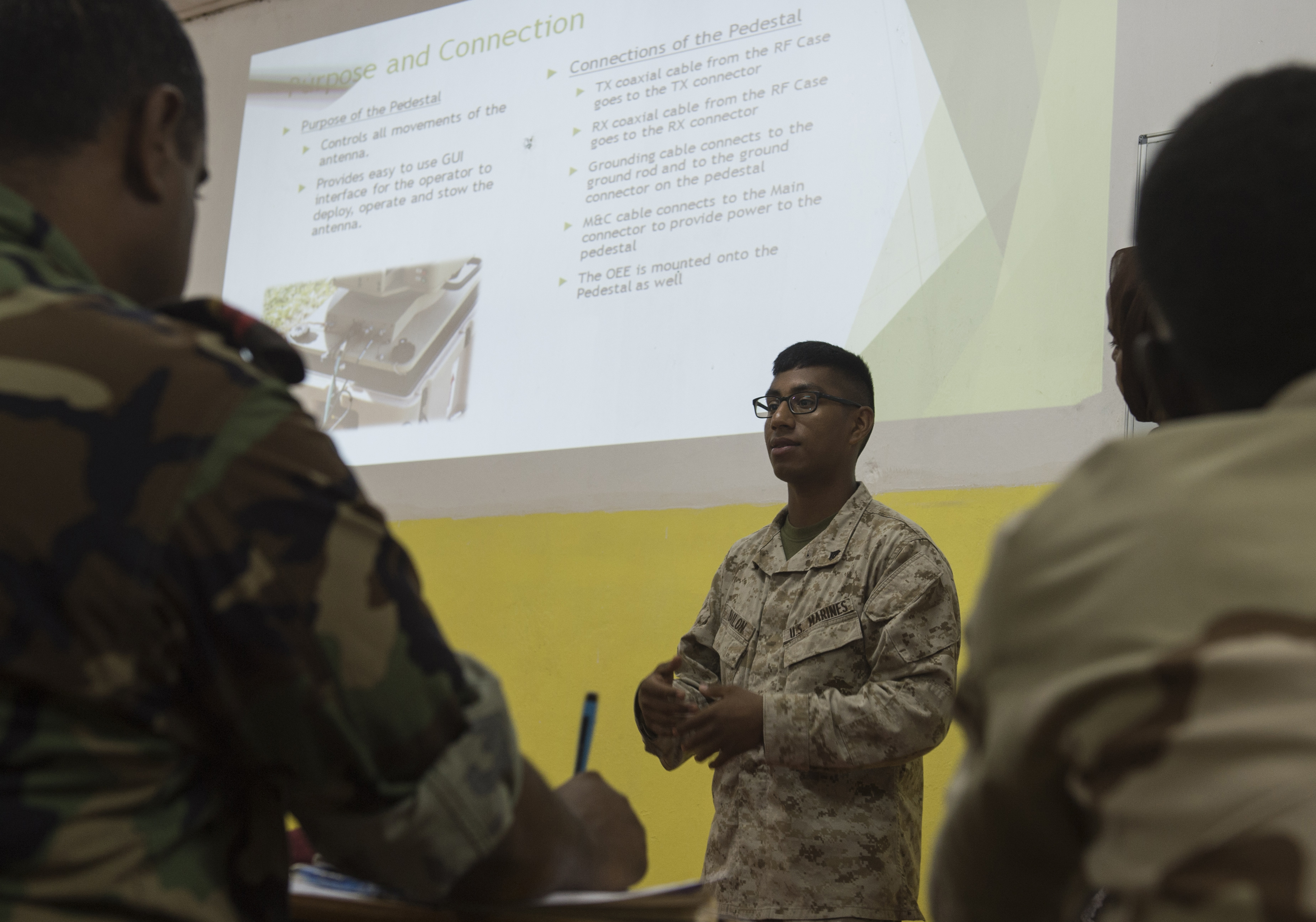 U.S. Marine Corps Cpl. Nehemias Bailon, Combined Joint Task Force-Horn of Africa, Africa Data Sharing Network (ADSN) help desk lead, explains a physical component of an ADSN terminal Feb. 18, 2016, in Djibouti. Members of the CJTF-HOA Communications Directorate met with Djiboutian Armed Forces ADSN soldiers and discussed how to configure and operate a terminal. (U.S. Air Force photo by Senior Airman Peter Thompson)