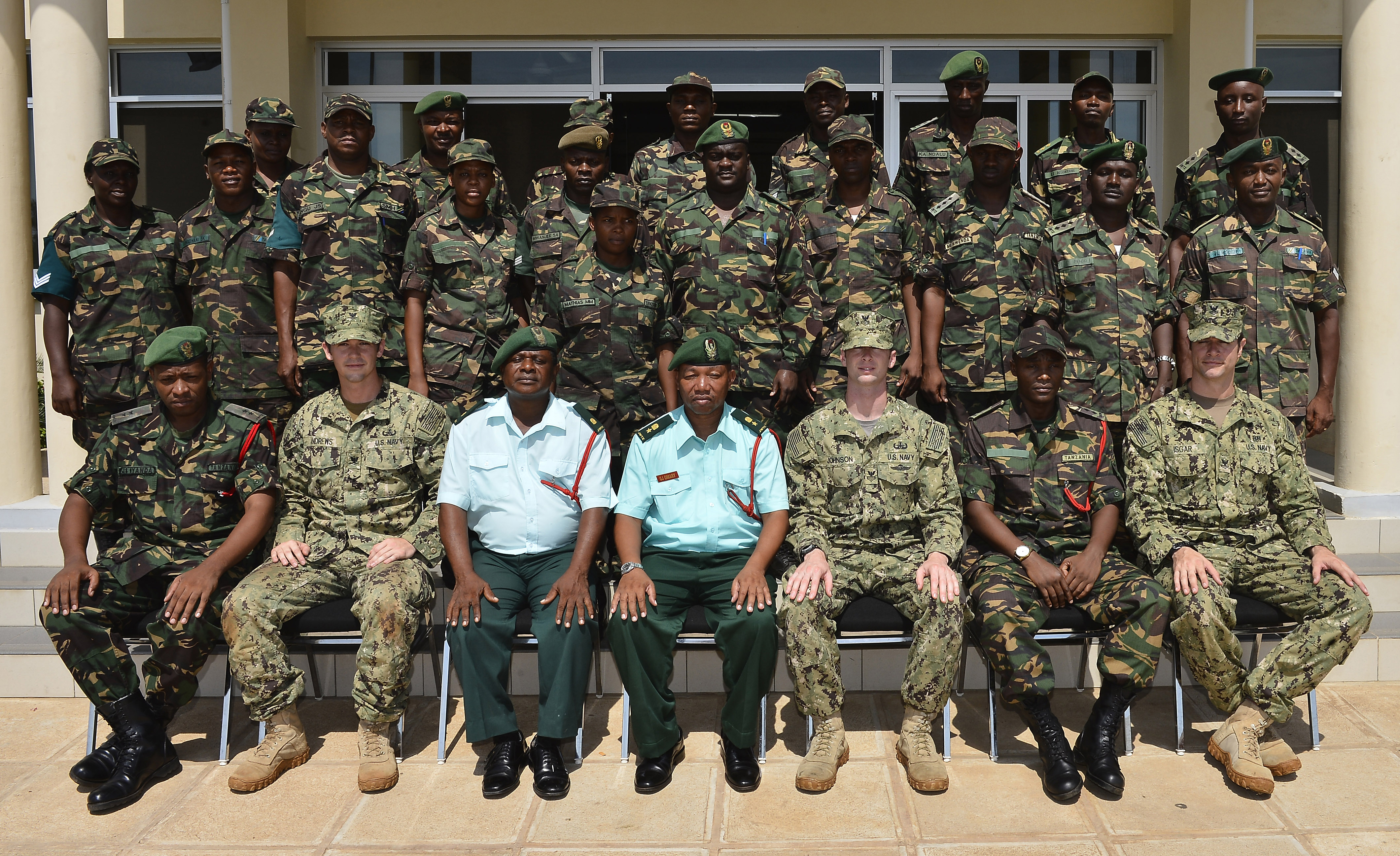 Members of the Tanzania People's Defence Force and Combined Joint Task Force-Horn of Africa's Explosive Ordnance Disposal Mobile Unit 1 pose for a photo after a graduation Feb. 17, 2016. The ceremony marked the conclusion of the 25-day Humanitarian Mine Action Level 1 training in Dar es Salaam, Tanzania. The training was the first phase in a curriculum designed to build a cadre of HMA/Counter-Improvised Explosive Device trainers within the TPDF. (U.S. Air Force photo by Tech. Sgt. Dan DeCook)