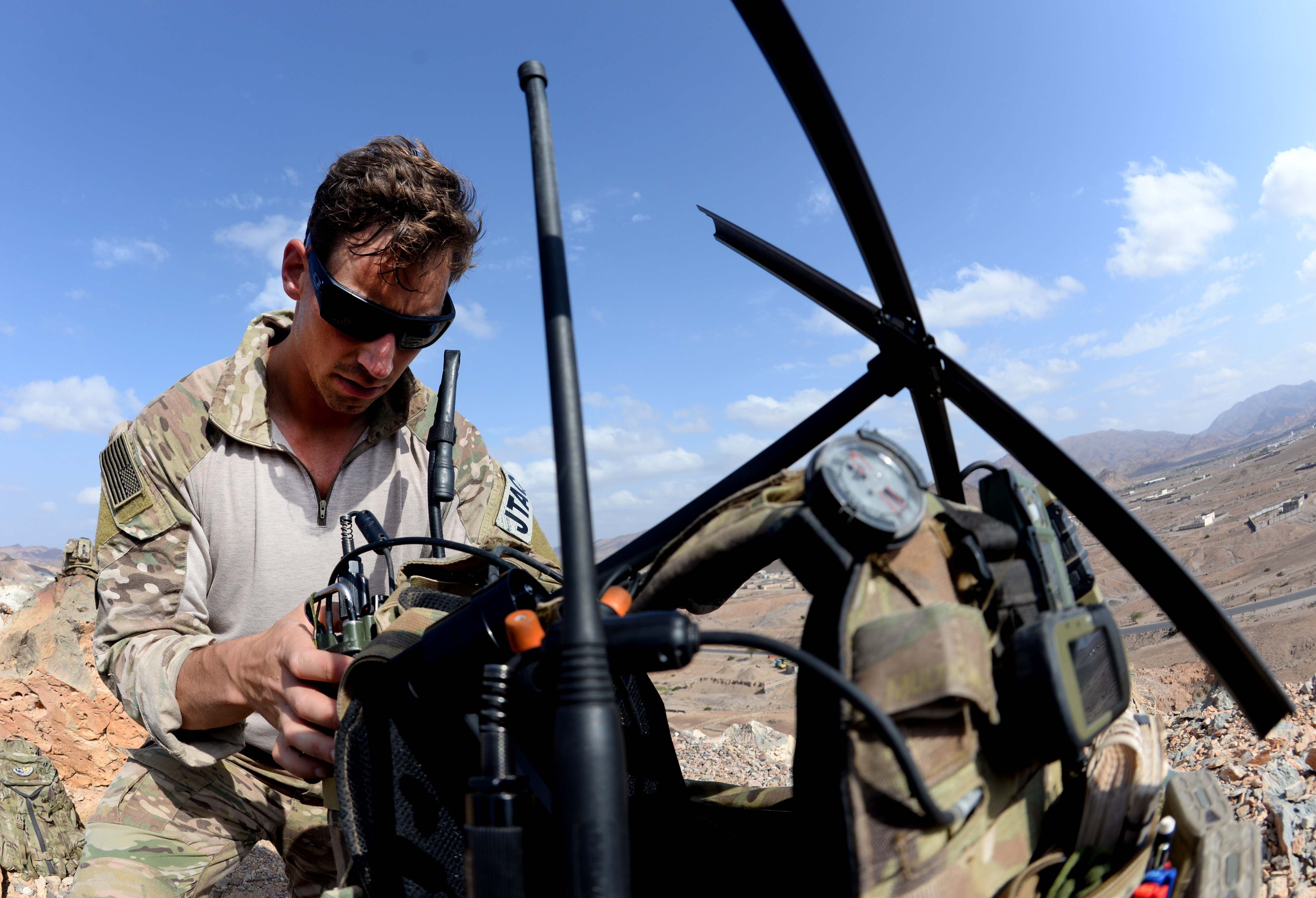 U.S. Air Force Staff Sgt. Corey Johnson, Tactical Air Control Party member, adjusts his satellite communications during a tactical exercise with the French Air Force Feb. 24, 2016, in Djibouti. Although aviators across the globe speak English, accents and distinctions from both the English-speaking or French-speaking personnel can create challenges under already stressful situations, and the exercise helped both forces become more familiar with each other's accents. (U.S. Air Force photo by Staff Sgt. Kate Thornton)