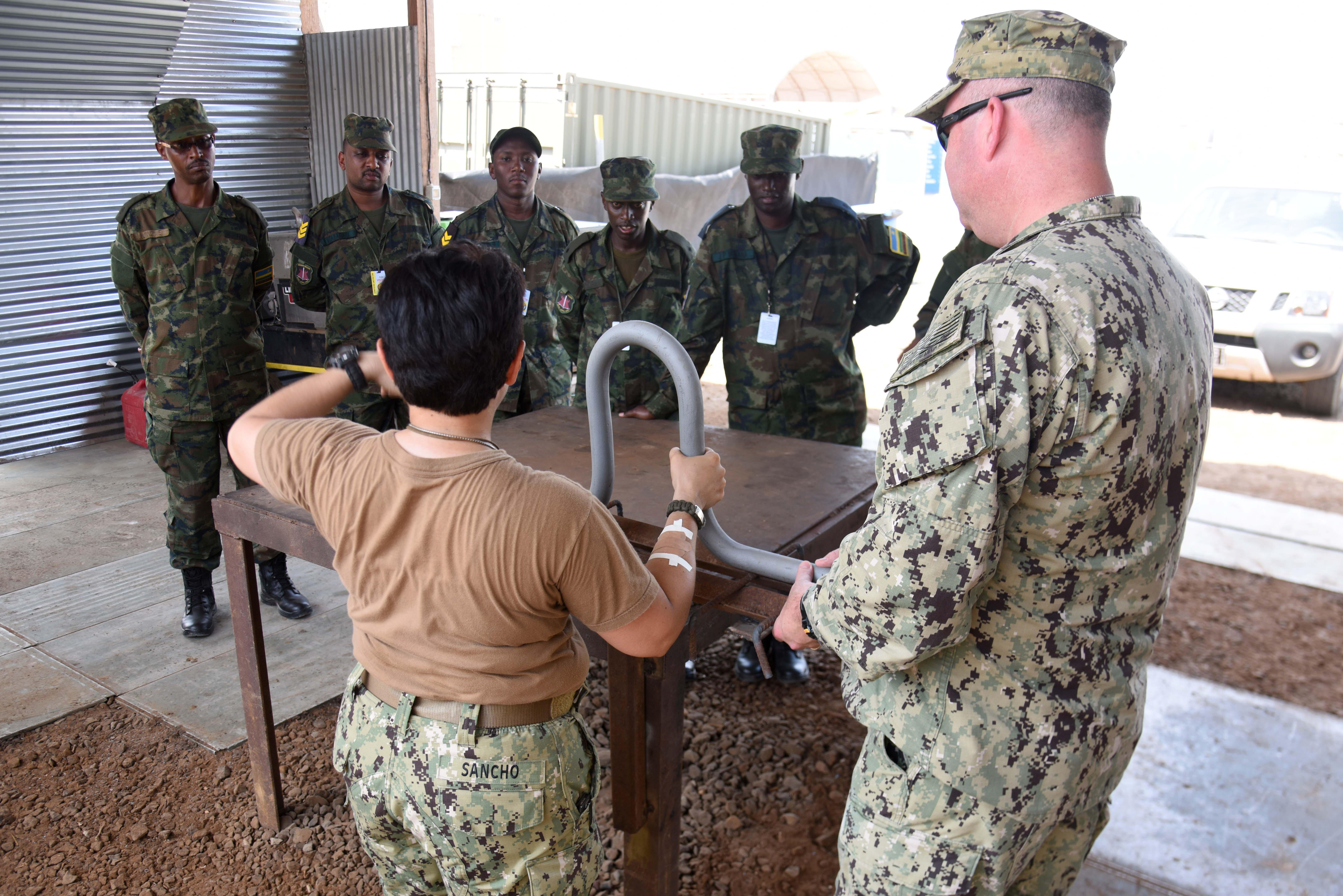 Seabees assigned to Naval Mobile Construction Battalion 22 display concrete support to Rwanda Defence Force engineers during their tour of Camp Lemonnier, Djibouti, Feb. 24, 2016. RDF members viewed U.S. expeditionary construction capabilities to solidify practices shared in prior exchanges with Combined Joint Task Force-Horn of Africa engineers. (U.S. Air Force photo by Staff Sgt. Victoria Sneed)