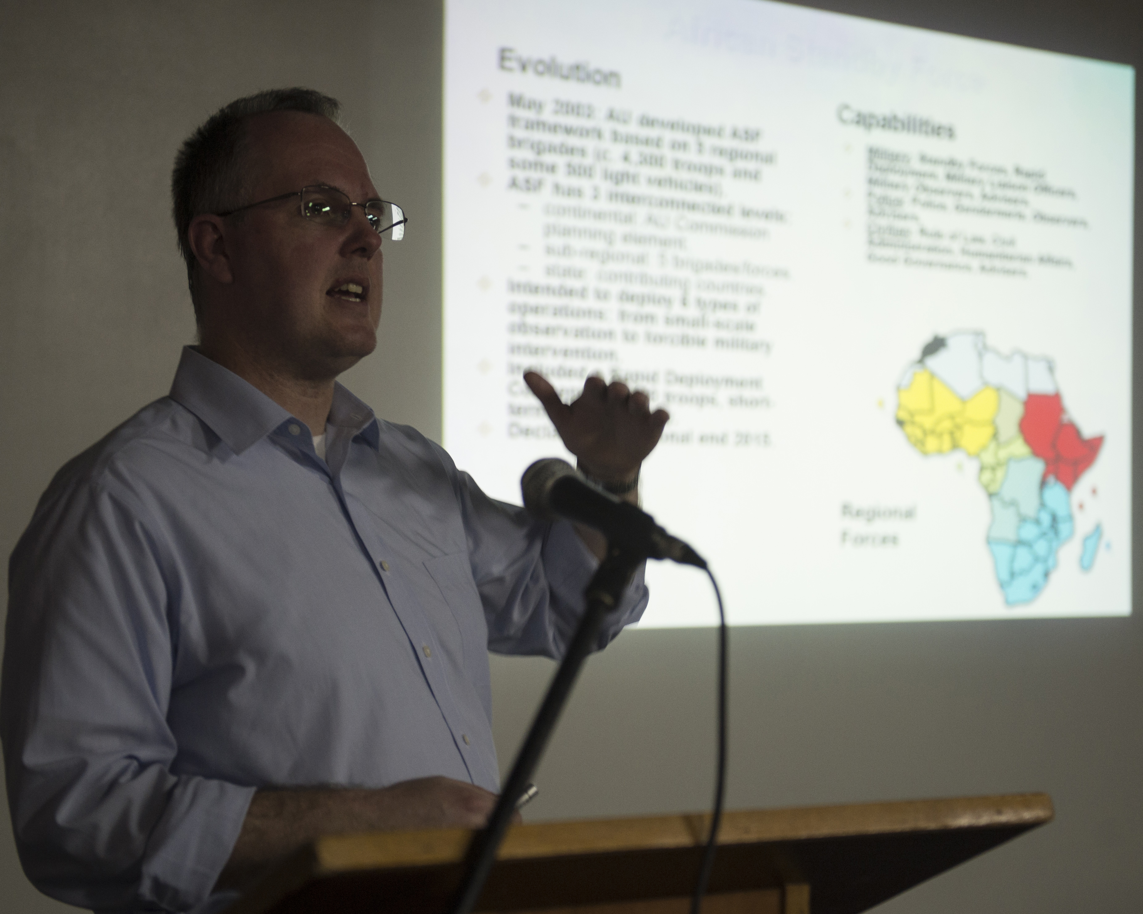 Dr. Paul D. Williams, Africa Center for Strategic Studies guest speaker, discusses Africa's peace and security architecture Mar. 2, 2016, at Camp Lemonnier, Djibouti. The Africa Center for Strategic Studies is a Department of Defense organization dedicated to supporting U.S. foreign and security policies. Combined Joint Task Force-Horn of Africa hosted the ACSS to discuss current issues and to learn more about the countries in East Africa. (U.S. Air Force photo by Staff Sgt. Peter Thompson)