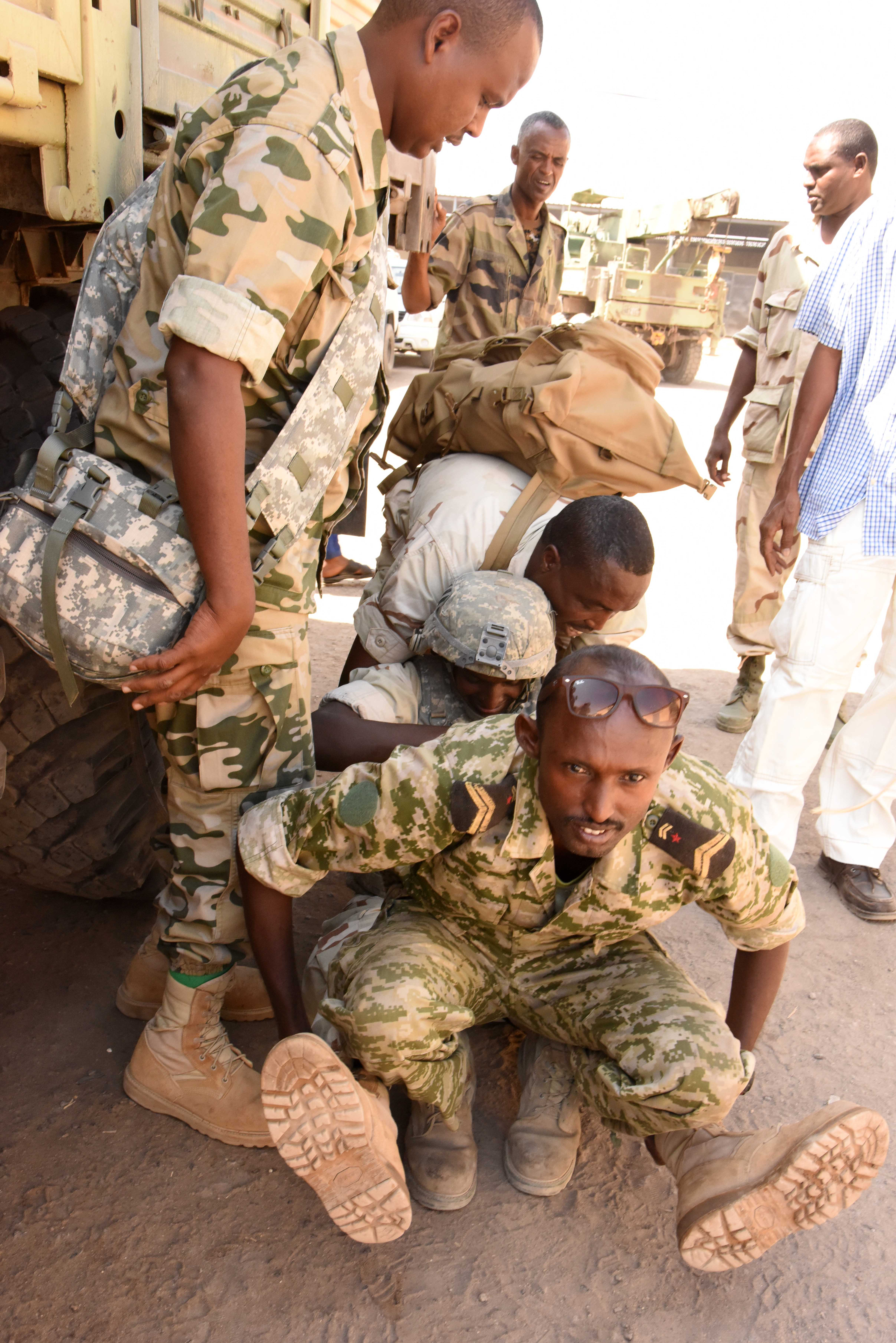 Djiboutian Armed Forces (FAD) soldiers lift a simulated injured comrade during a Combat Lifesaver Course scenario at the Central Management of Materials and Engineering Services compound, Djibouti, Mar. 5, 2016. FAD soldiers learned diagnosis, transport and treatment of battlefield wounds to prepare them for future deployments. (U.S. Air Force photo by Staff Sgt. Victoria Sneed)