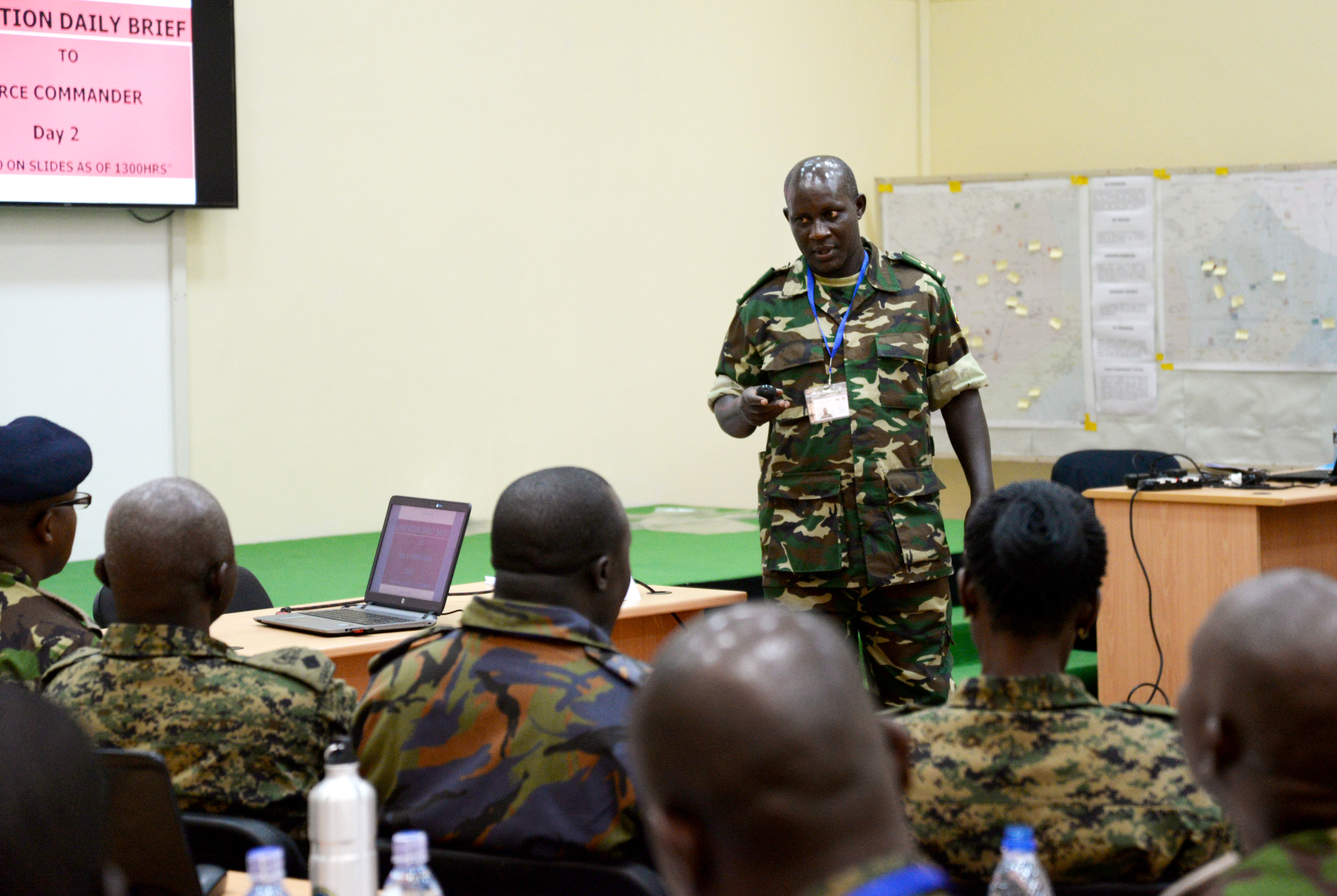 An officer from the Burundi National Defence Force briefs his staff as acting commander for a simulated scenario March 1, 2016, during an exercise to complete a staff officers course in Nairobi, Kenya. At the beginning of the course, the officers were split into six main directorates necessary for successful military operations: logistics and personnel, intelligence, public information, civil affairs, military operations, and command leadership. (U.S. Air Force photo by Staff Sgt. Kate Thornton)