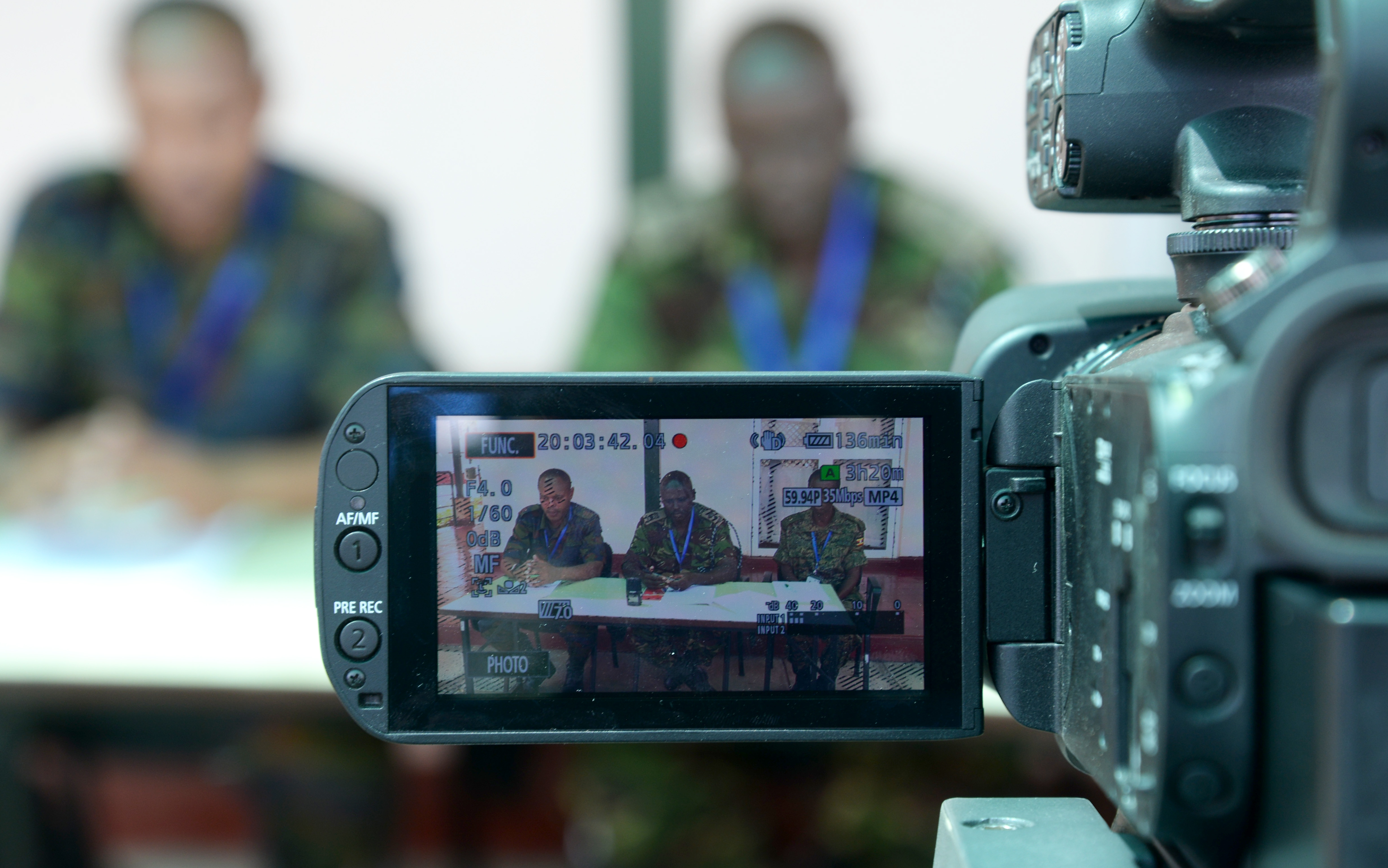 A camera records a simulated press conference March 3, 2016, during an exercise to complete a staff officers course in Nairobi, Kenya.  Course mentors recorded the practice conference to show the officers their performance and ultimately lead to improvement. (U.S. Air Force photo by Staff Sgt. Kate Thornton)