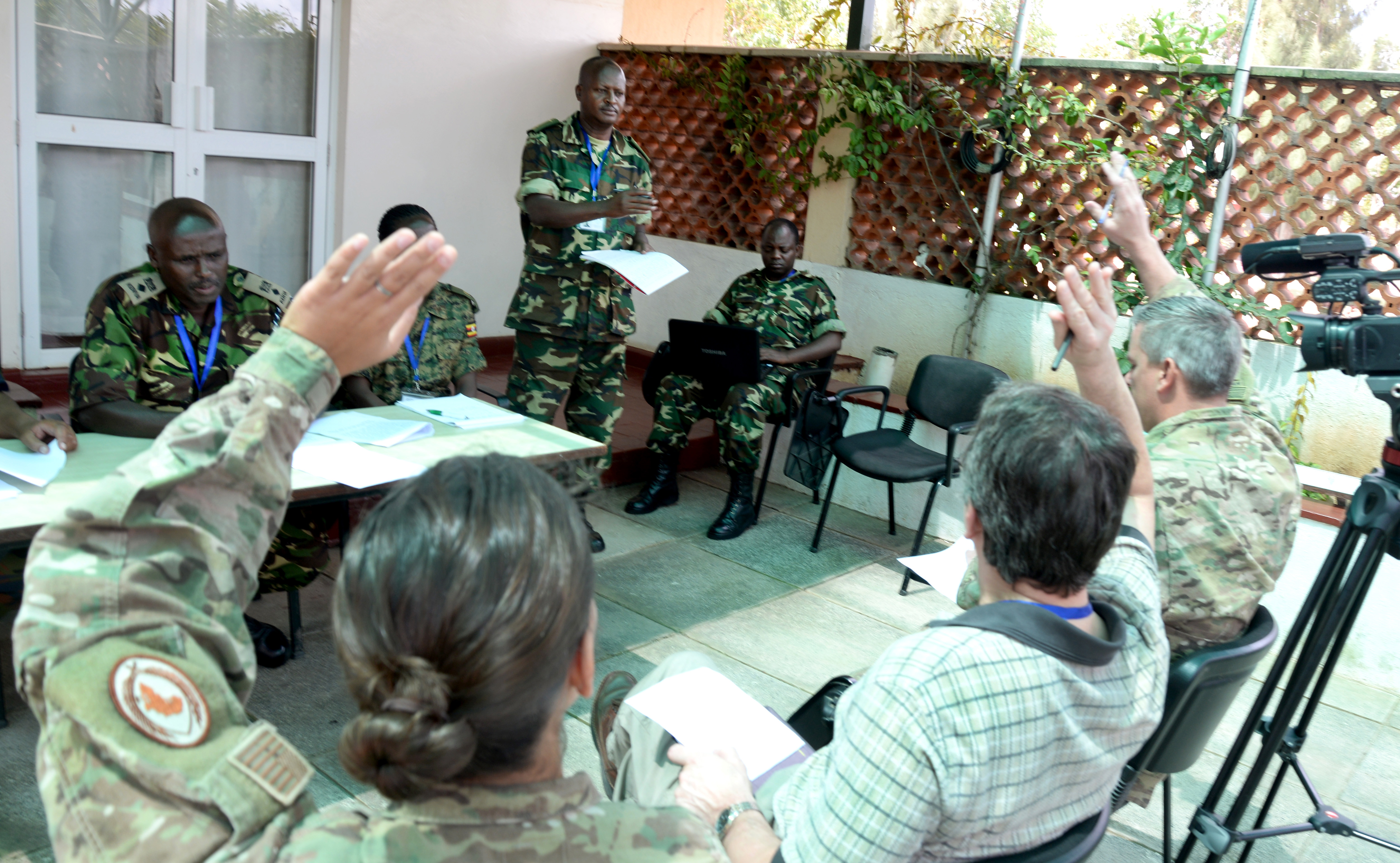 U.S. military and civilian mentors role play as members of the media and ask questions at a simulated press conference March 3, 2016, during an exercise to complete an AMISOM staff officers course in Nairobi, Kenya. The practice press conference tested the public information officers' ability to prepare the conference, media and staff. (U.S. Air Force photo by Staff Sgt. Kate Thornton)