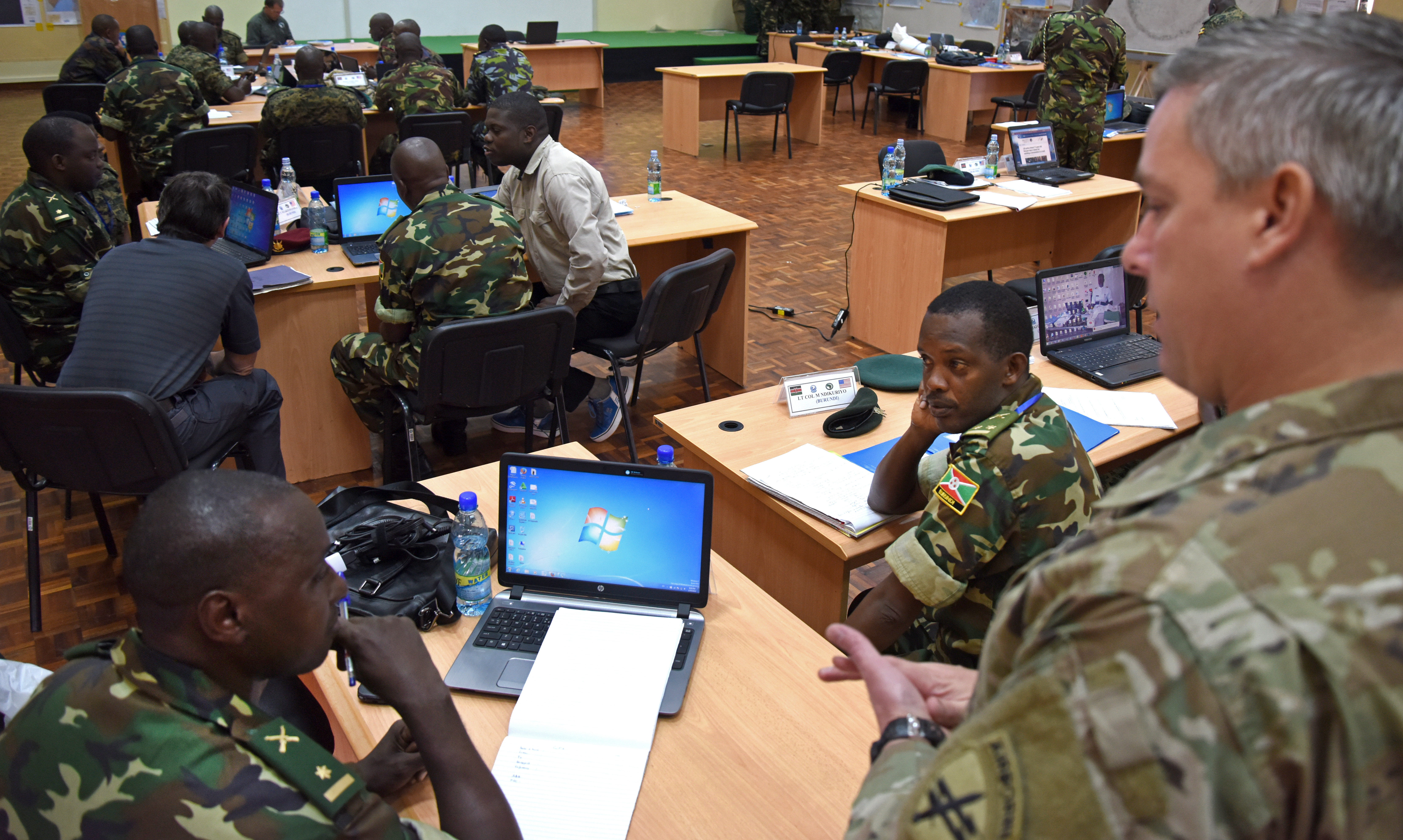 U.S. Army Capt. Erik Buendia, 403rd Civil Affair Battalion, mentors Burundi and Kenyan military officers on civil military engagement Feb. 29, 2016, during an African Union Mission in Somalia staff officers course in Nairobi, Kenya. The course covered six main functions necessary for successful military operations:  logistics and personnel, intelligence, public information, civil affairs, military operations, and command leadership. (U.S. Air Force photo by Staff Sgt. Kate Thornton)