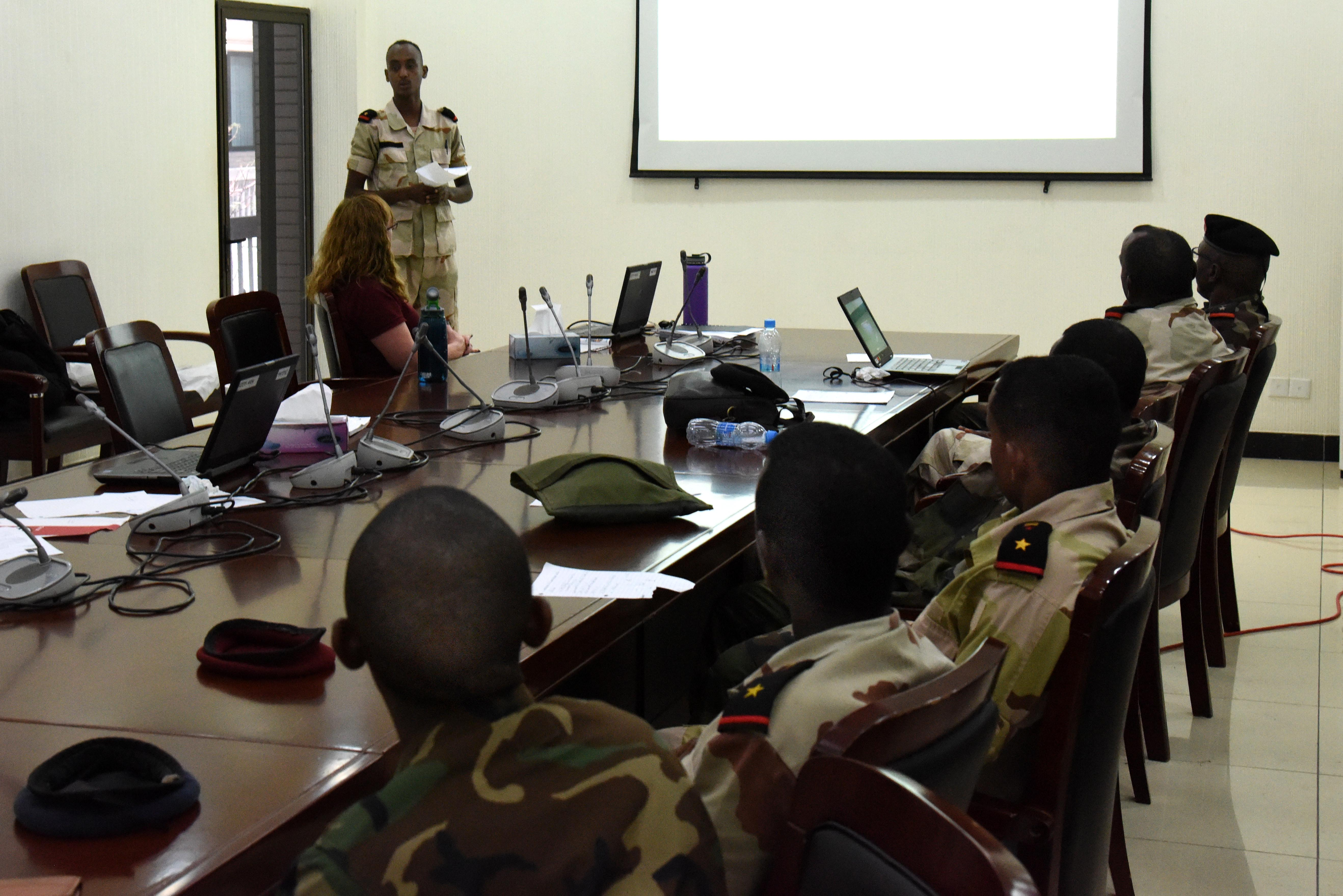 A Djiboutian Armed Forces (FAD) member presents information gathered from open sources during an open source intelligence course at the People's Palace, Djibouti, March 5-10, 2016. More than 15 FAD members learned to gather pertinent information from Internet sources such as search engines, use of geospatial imagery, social media, and other publications. (U.S. Air Force photo by Staff Sgt. Victoria Sneed)