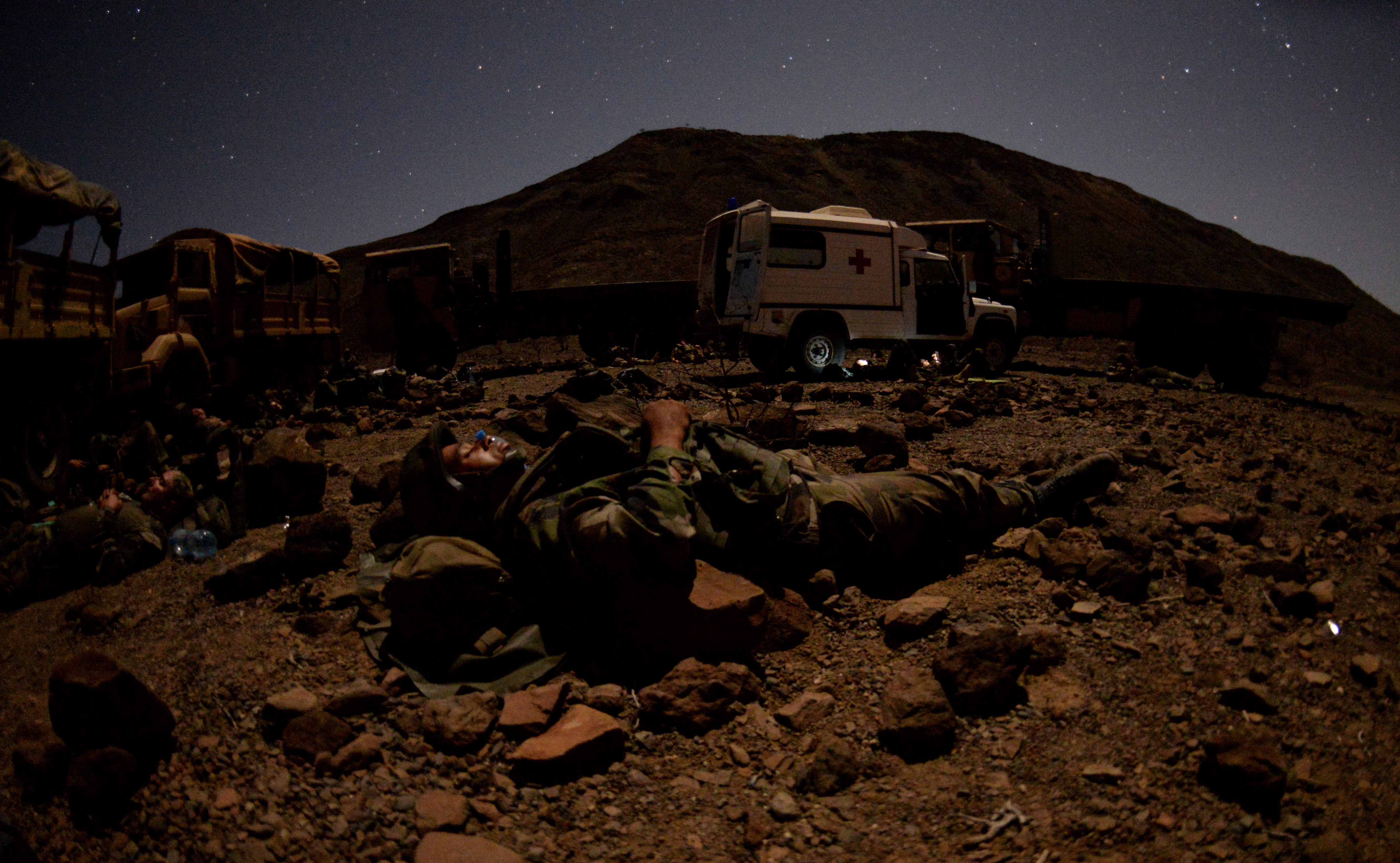 French and U.S. Army Soldiers bed down during a field training exercise March 16, 2016, in Arta, Djibouti. Soldiers got as much sleep as they could between attacks from simulated opposing forces. (U.S. Air Force photo by Staff Sgt. Kate Thornton)