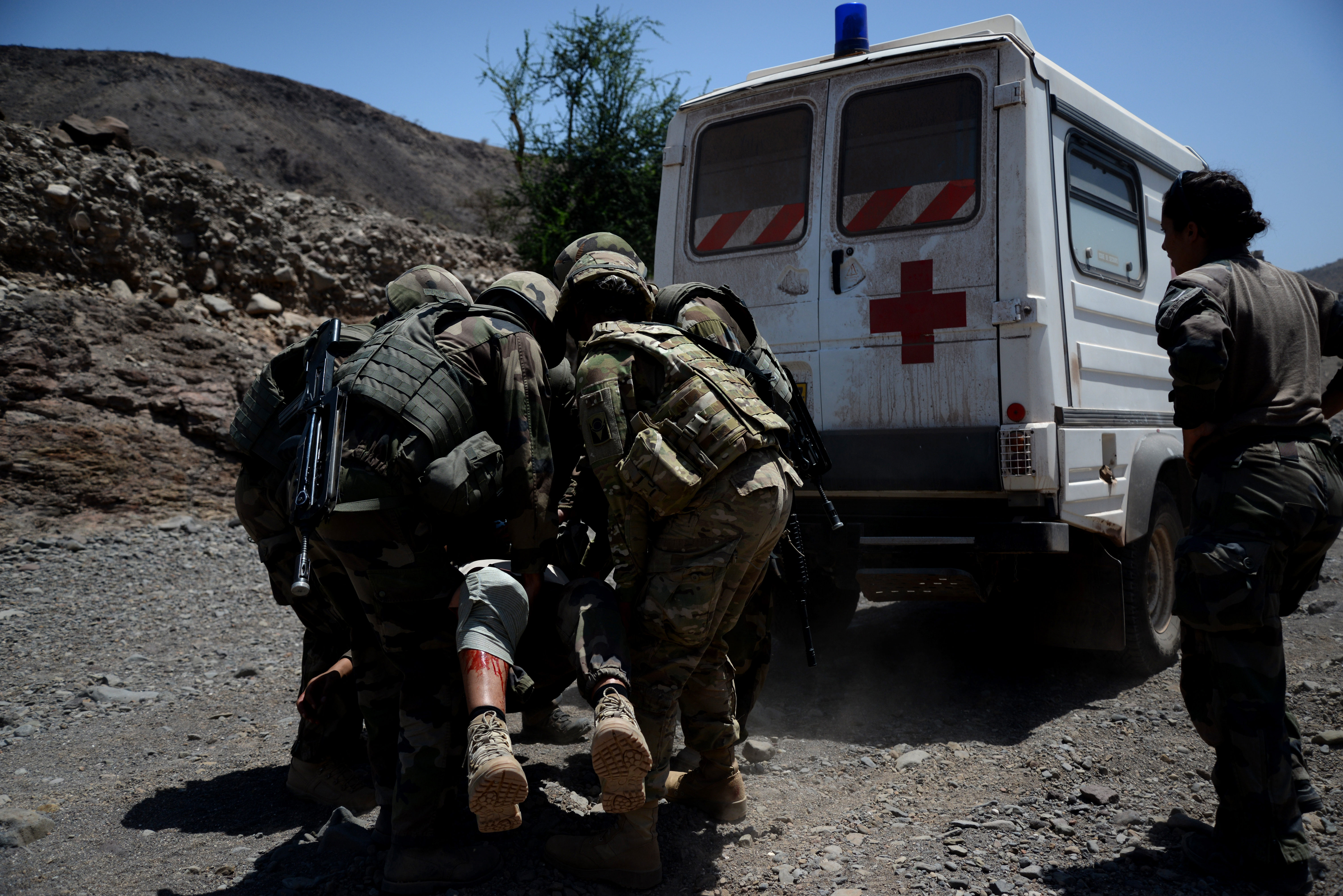 French and U.S. Army Soldiers carry a simulated injured victim to safety during a field training exercise March 17, 2016, in Arta, Djibouti. This is one of 60 engagements U.S. and French forces have held since September, providing another opportunity to build teamwork amongst the allies. (U.S. Air Force photo by Staff Sgt. Kate Thornton)