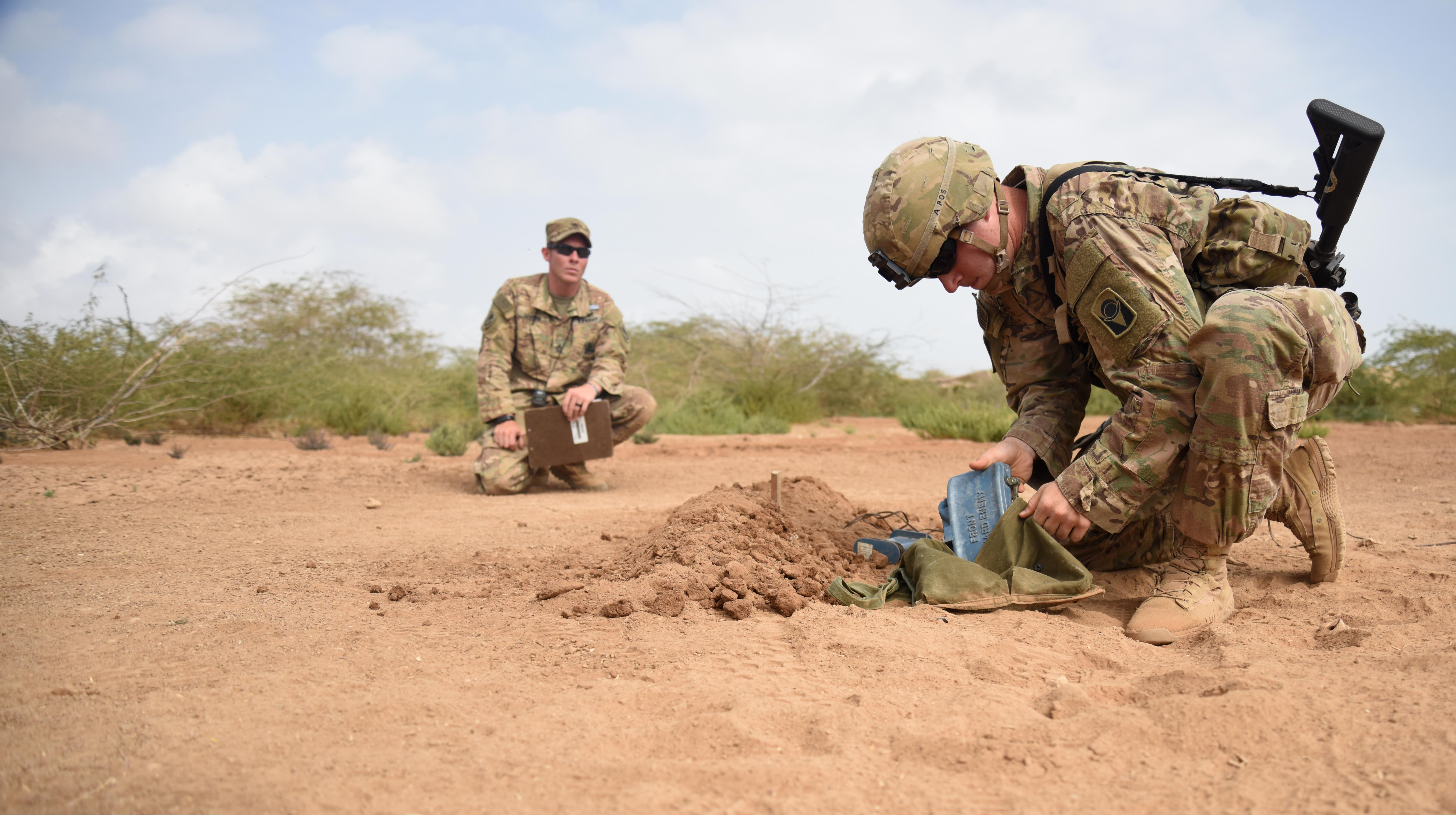 U.S. Army Spc. Jeremy Cicio, Expert Infantry Badge candidate, performs a mortar test March 29, 2016, during the weapons portion of the EIB course at Camp Lemonnier, Djibouti. The weapons portion involved a variety of systems and required proficient knowledge of preparing each weapon for use, all of which were timed. (U.S. Air Force photo by Staff Sgt. Kate Thornton)