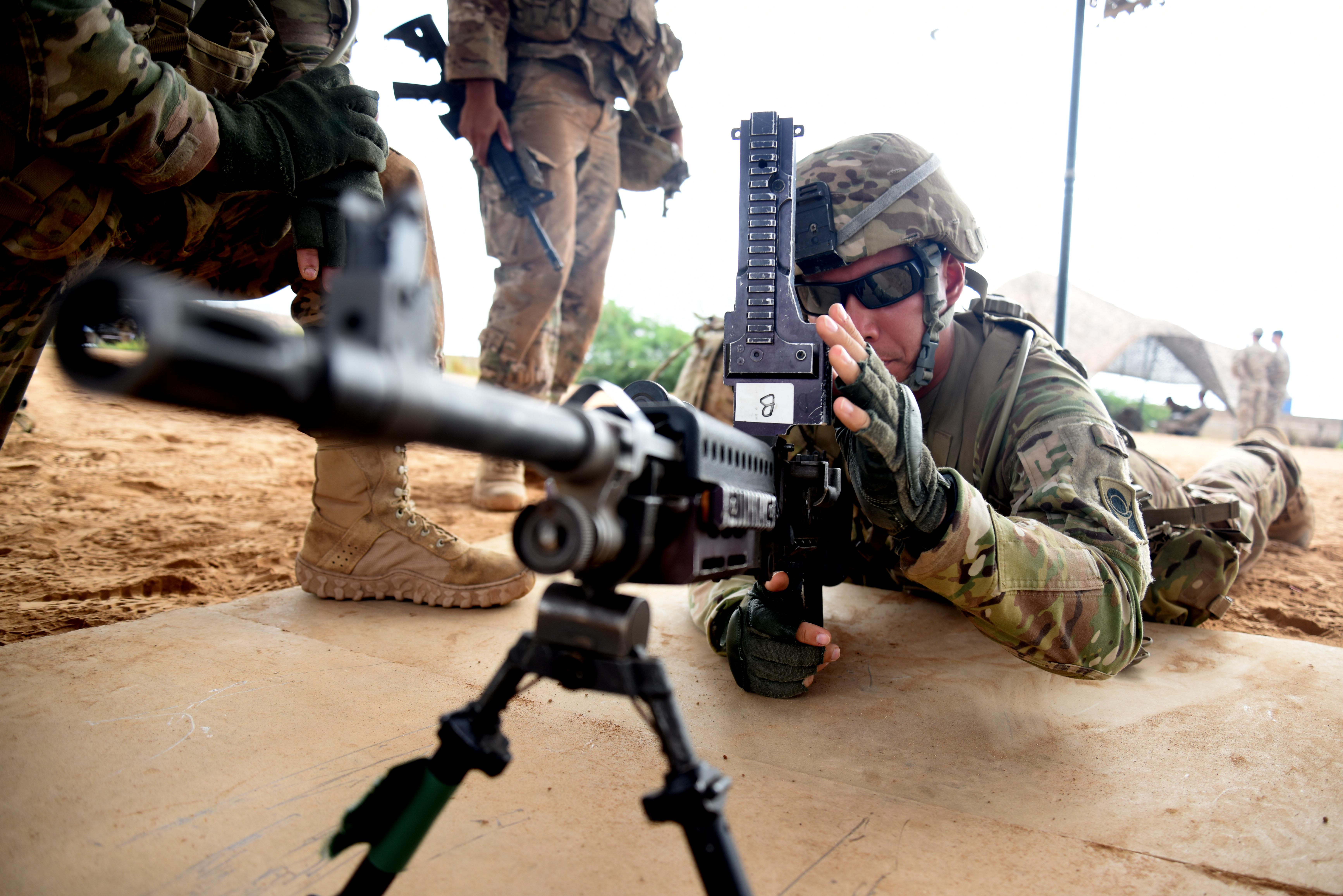 "U.S. Army 1st Lt. Alexander Repp, Expert Infantry Badge candidate, practices before approaching the testing tent March 29, 2016, during the weapons portion of the EIB course at Camp Lemonnier, Djibouti. As they moved through each day and each test, they received a ""go"" or ""no go"" indicating their status. (U.S. Air Force photo by Staff Sgt. Kate Thornton)"