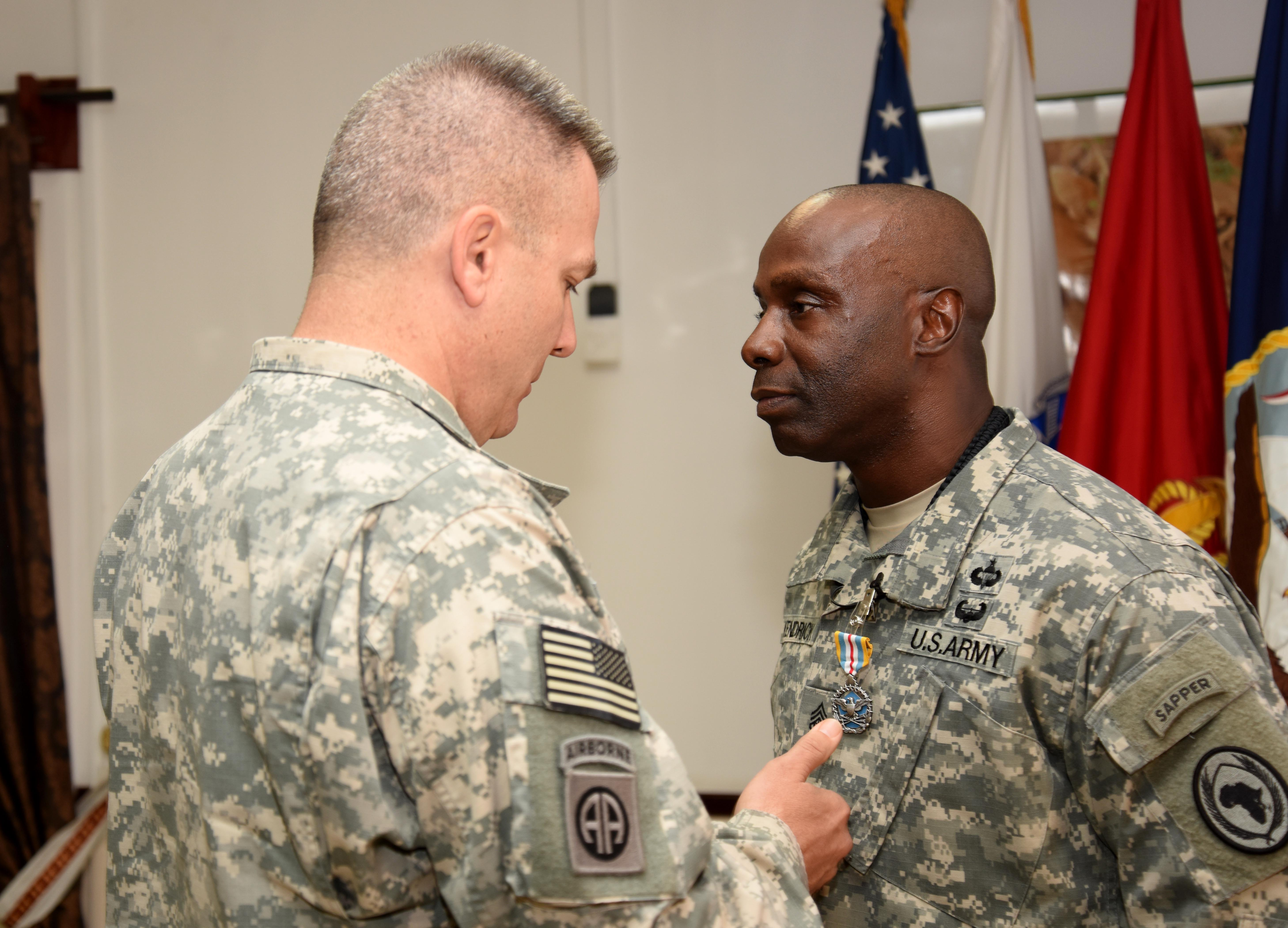 U.S. Army Command Sgt. Maj. Butler Kendrick Jr., Combined Joint Task Force-Horn of Africa command senior enlisted leader, receives the Defense Superior Service Medal at his farewell awards ceremony March 27, 2016. During the ceremony, Kendrick said farewell to colleagues and staff members before heading back to the U.S. (U.S. Air Force photo by Staff Sgt. Kate Thornton)