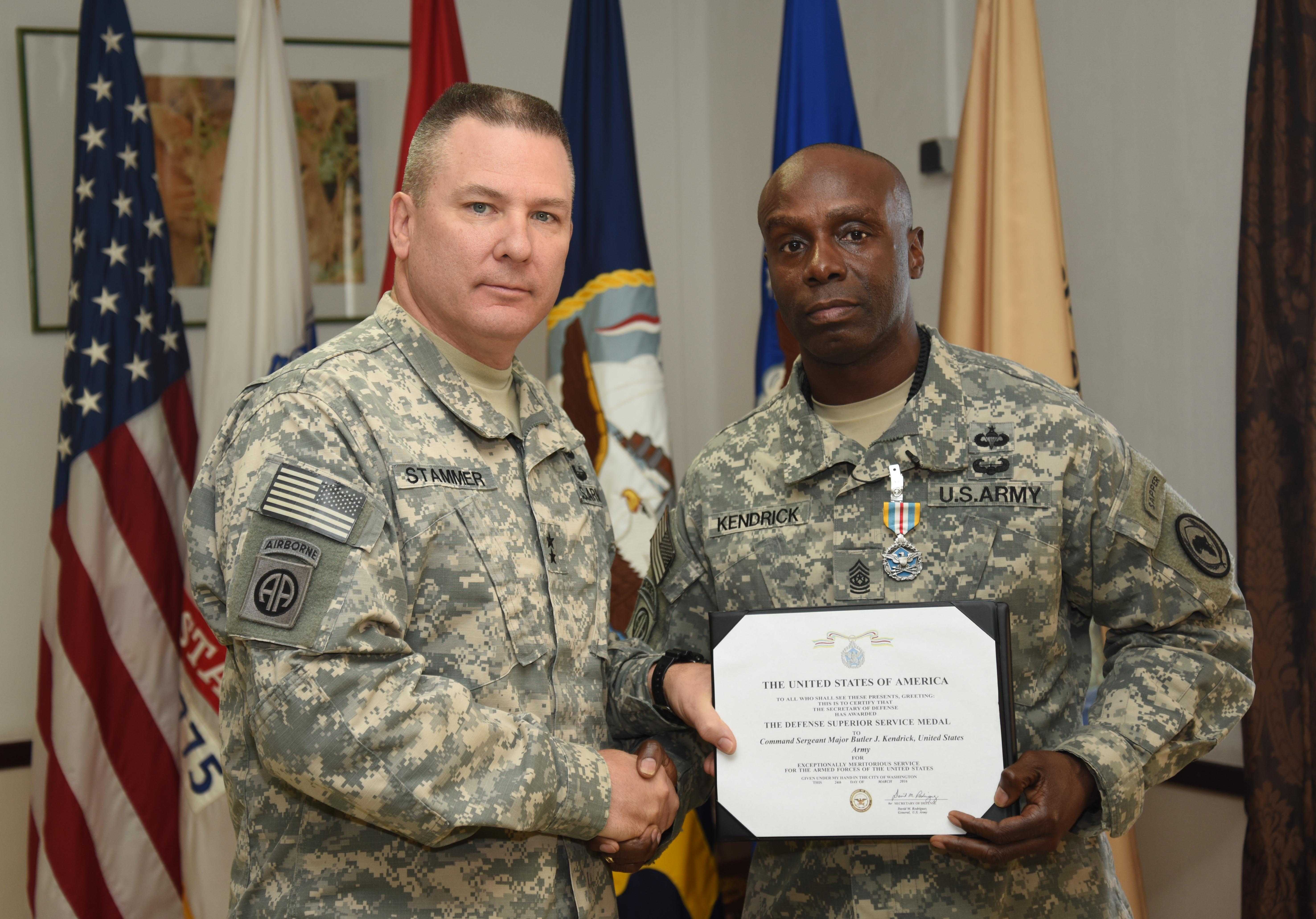 U.S. Army Maj. Gen. Mark Stammer, Combined Joint Task Force-Horn of Africa commanding general, awards U.S. Army Command Sgt. Maj. Butler Kendrick Jr., CJTF-HOA command senior enlisted leader, the Defense Superior Service Medal at his farewell awards ceremony March 27, 2016. Butler has been the command senior enlisted leader since June. (U.S. Air Force photo by Staff Sgt. Kate Thornton)