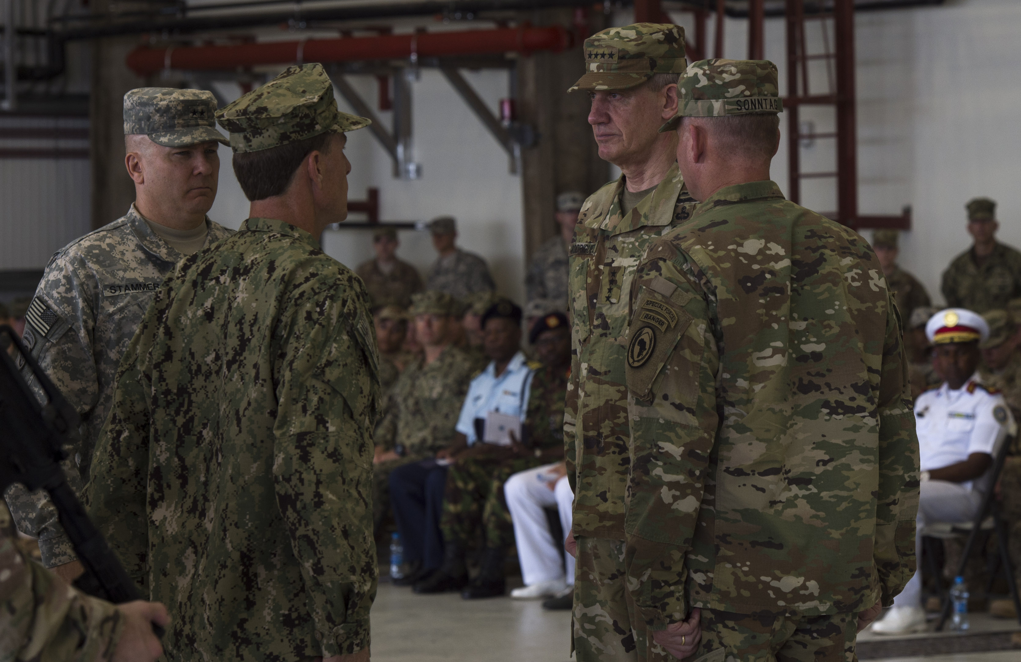Combined Joint Task Force-Horn of Africa's senior leadership prepare to transfer command and responsibility of the unit from U.S. Army Maj. Gen. Mark Stammer, CJTF-HOA outgoing commander, to Brig. Gen. Kurt Sonntag during a change of command ceremony April 13, 2016, at Camp Lemonnier, Djibouti. Passing of the flag during a change of command is a military tradition that symbolizes the passing of responsibility from the old commander to the new commander. (U.S. Air Force photo by Staff Sgt. Eric Summers Jr.)