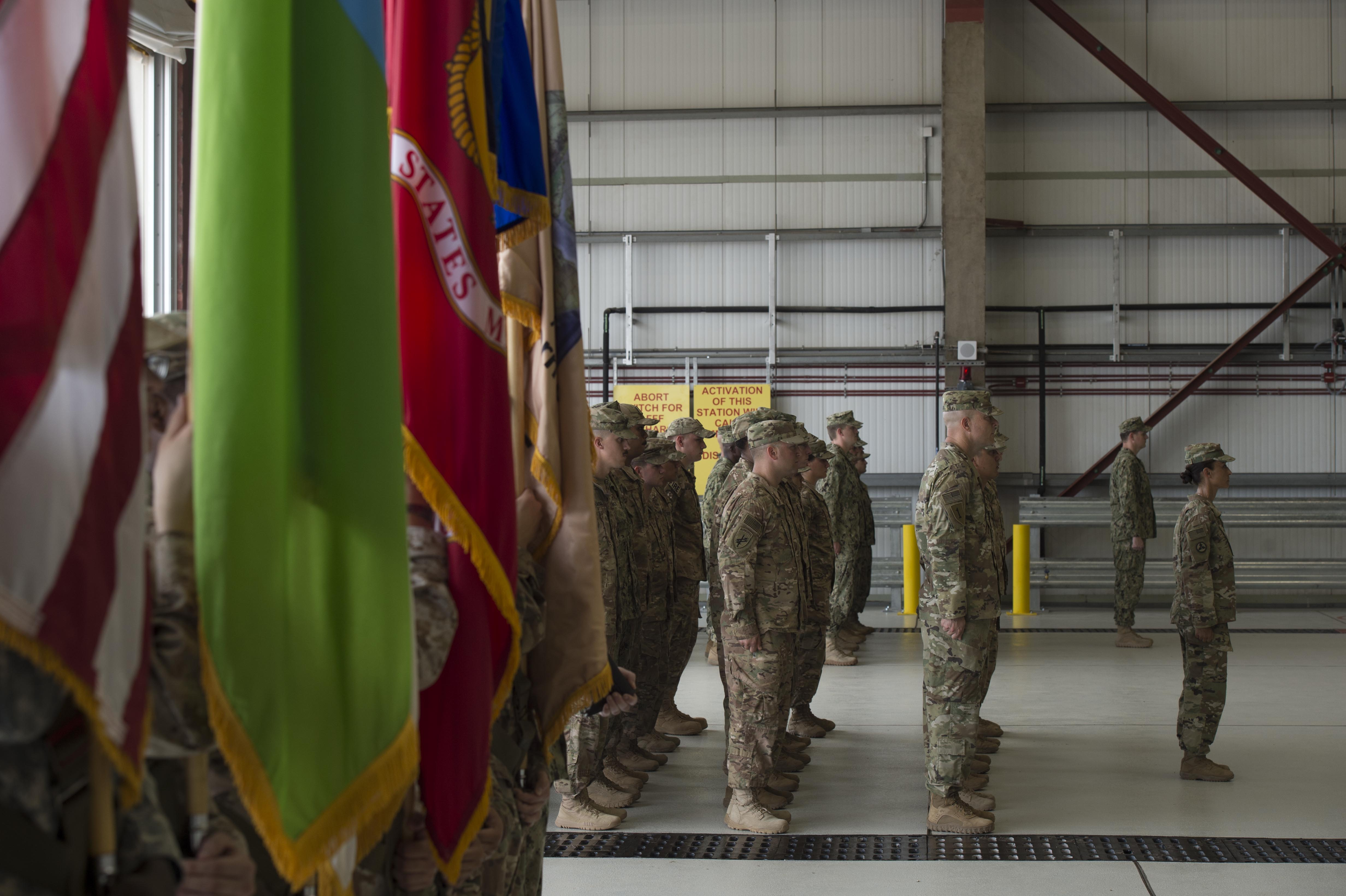 Members of Combined Joint Task Force-Horn of Africa stand at attention as responsibilities of the unit are transferred to a new commander during the CJTF-HOA change of command ceremony April 13, 2016, at Camp Lemonnier, Djibouti. The ceremony also featured a transfer of responsibility during which U.S. Navy Command Master Chief Geoffrey P. Steffee assumed the role of CTJF-HOA command senior enlisted leader from U.S. Army Command Sgt. Maj. Butler Kendrick Jr. (U.S. Air Force photo by Staff Sgt. Eric Summers Jr.)