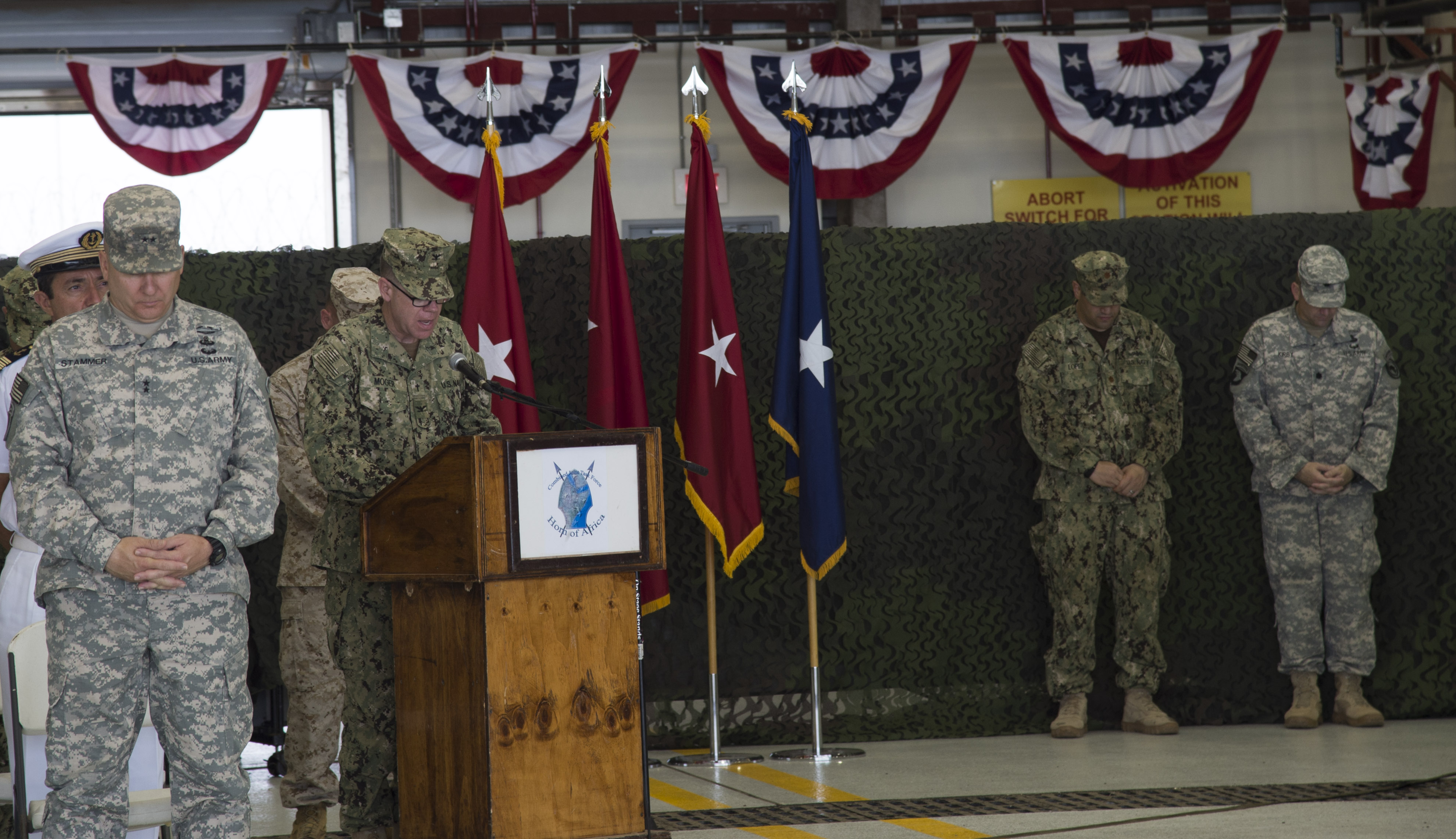 U.S. Army Chaplain Capt. J. Travis Moger, Combined Joint Task Force-Horn of Africa director of religious affairs, gives an invocation at the beginning of the CJTF-HOA change of command ceremony April 13, 2016, at Camp Lemonnier, Djibouti. Brig. Gen. Kurt Sonntag assumed command of CJTF-HOA after serving as commanding general for the Special Operations Command South at Homestead Air Reserve Base, Fla. (U.S. Air Force photo by Staff Sgt. Eric Summers Jr.)