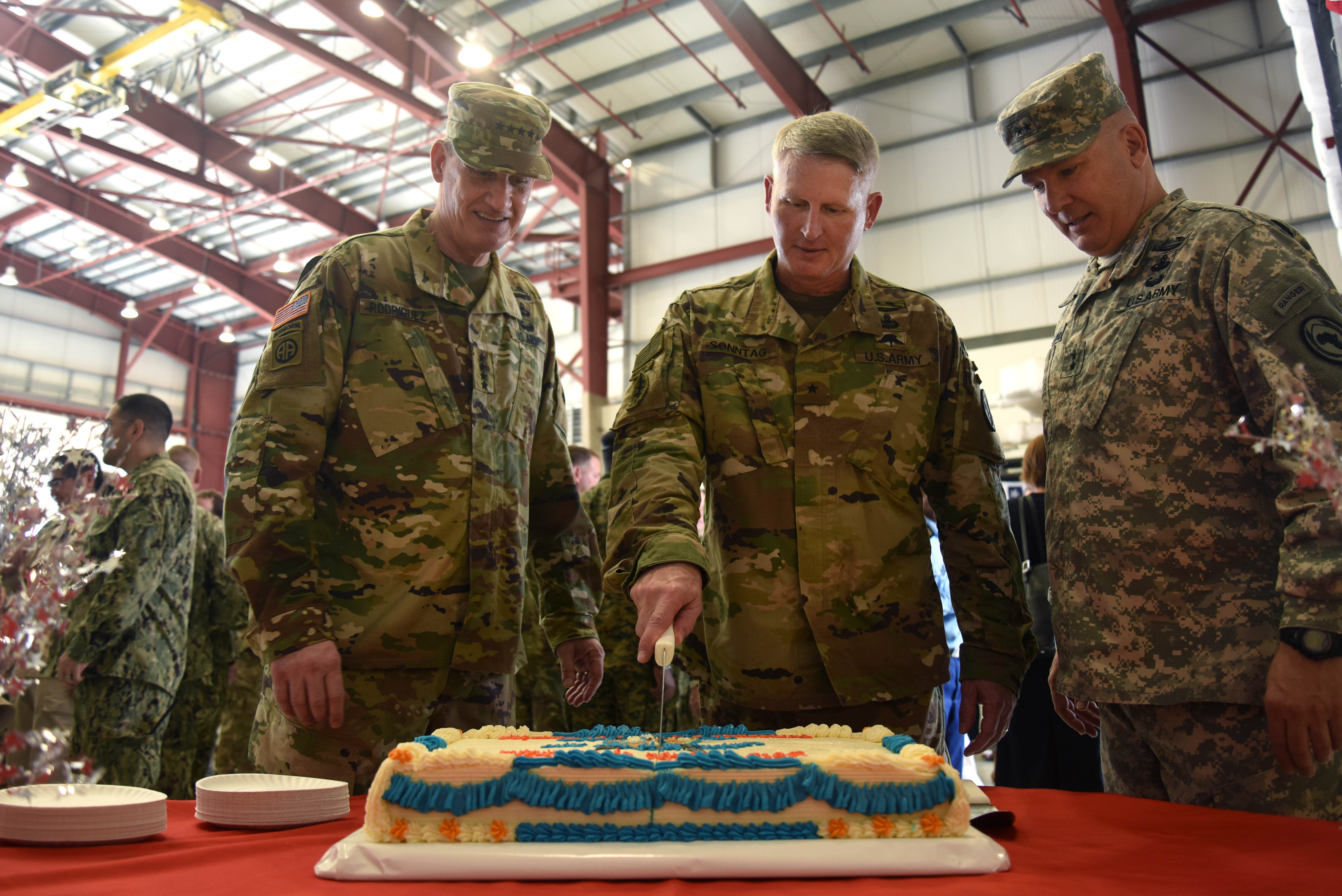 (From the left) U.S. Army Gen. David M. Rodriguez, U.S. Africa Command commanding general, Brig. Gen. Kurt Sonntag, new Combined Joint Task Force-Horn of Africa commanding general, and Maj. General Mark Stammer, departing CJTF-HOA commanding general, cut a cake during a change of command ceremony post-reception April 13, 2016, at Camp Lemonnier, Djibouti. Service members, diplomats and multi-national guests attended the ceremony and met the new commander. (U.S. Air Force photo by Staff Sgt. Kate Thornton)