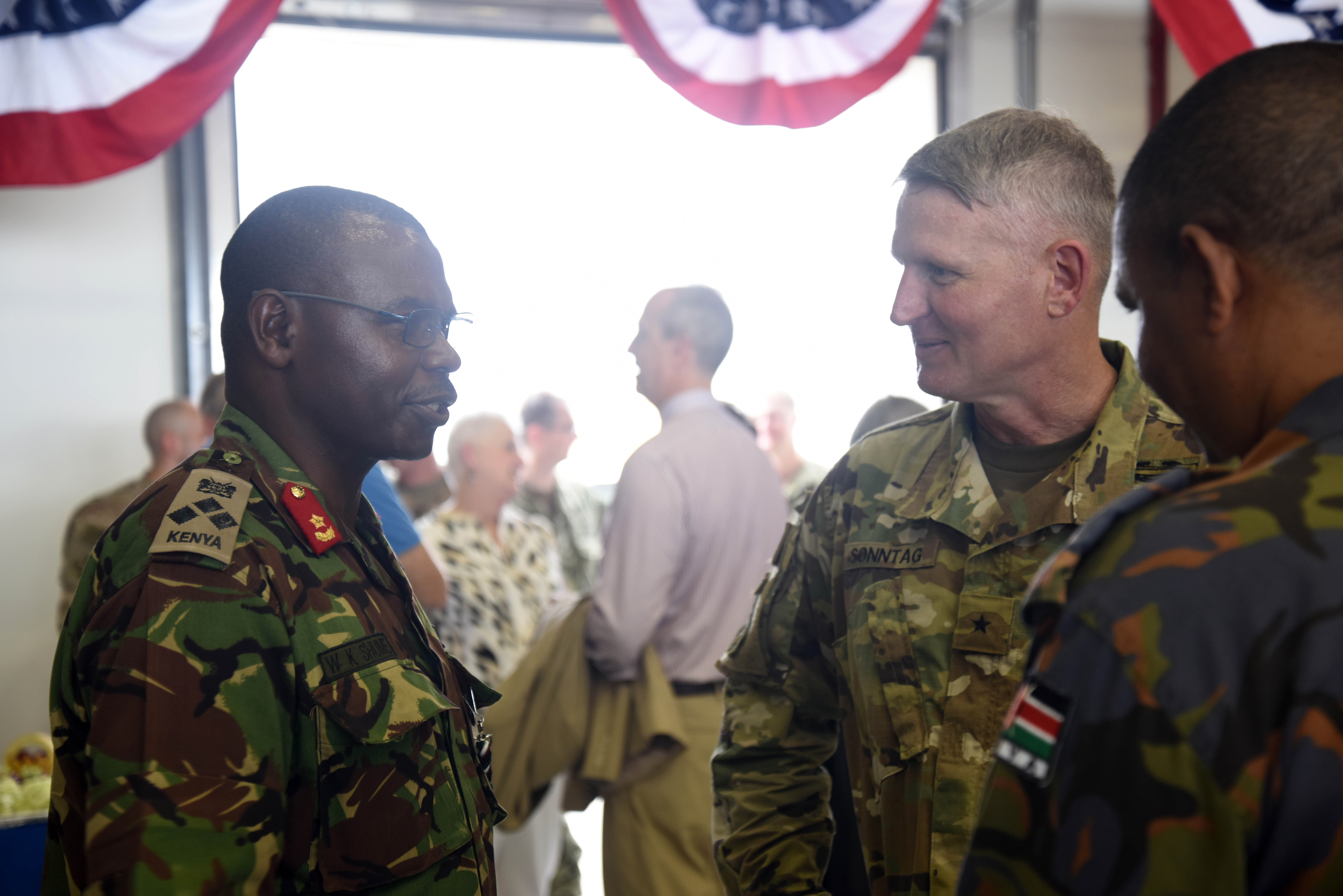 U.S. Army Brig. Gen. Kurt Sonntag, Combined Joint Task Force-Horn of Africa commanding general, meets partner-nation service members during a change of command ceremony post-reception April 13, 2016, at Camp Lemonnier, Djibouti. Service members, diplomats and multi-national guests attended the ceremony and met the new commander. (U.S. Air Force photo by Staff Sgt. Kate Thornton)