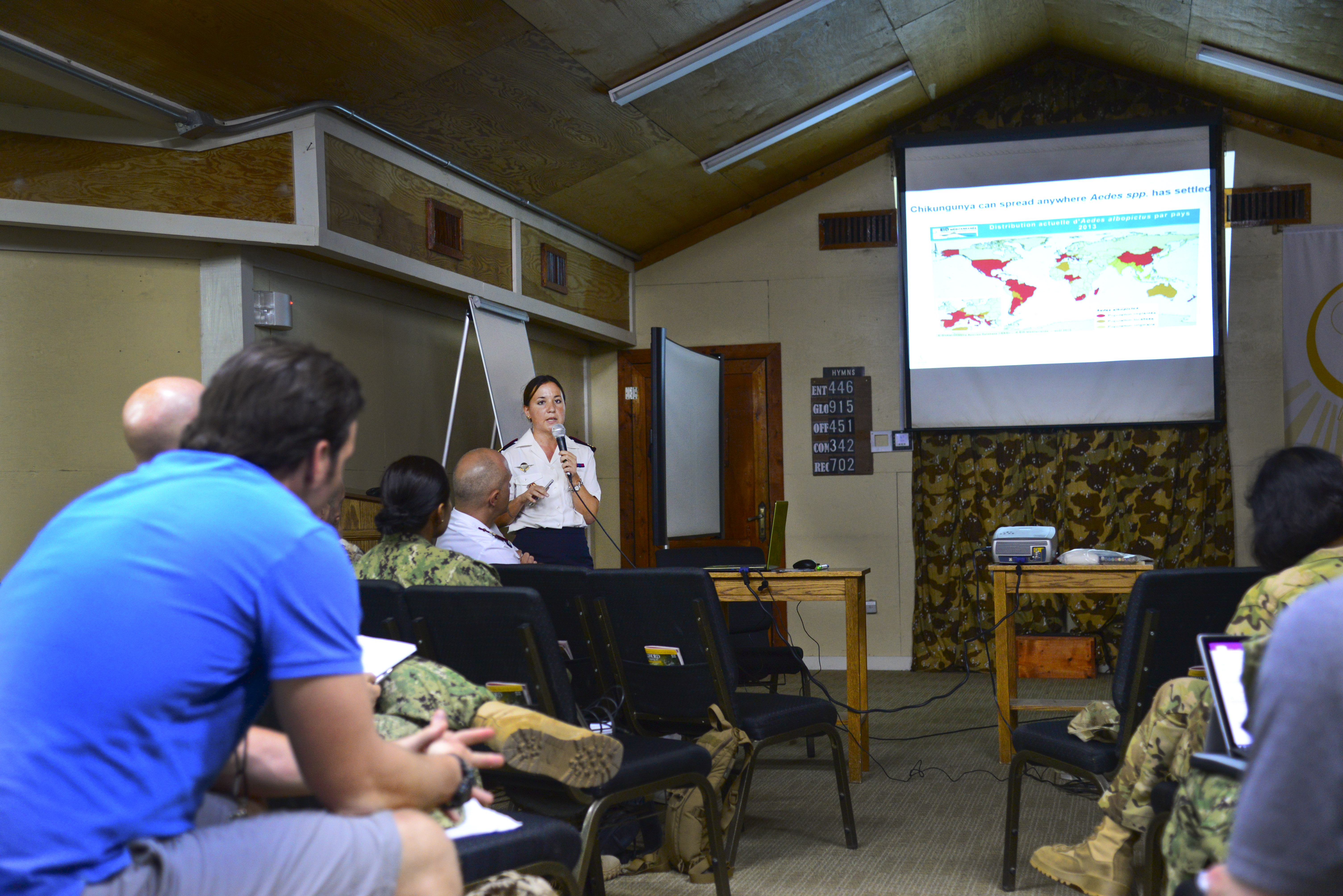 French Army Capt. Emilie Javelle, Internal medicine clinician, teaches medical professionals about the Chikungunya virus during the Military Tropical Medicine seminar May 11, 2016 at Camp Lemonnier, Djibouti. Javelle talked about the symptoms and treatments of Chikungunya as there is currently no vaccine for the disease. (U.S. Air Force photo by Senior Airman Benjamin Raughton/Released)