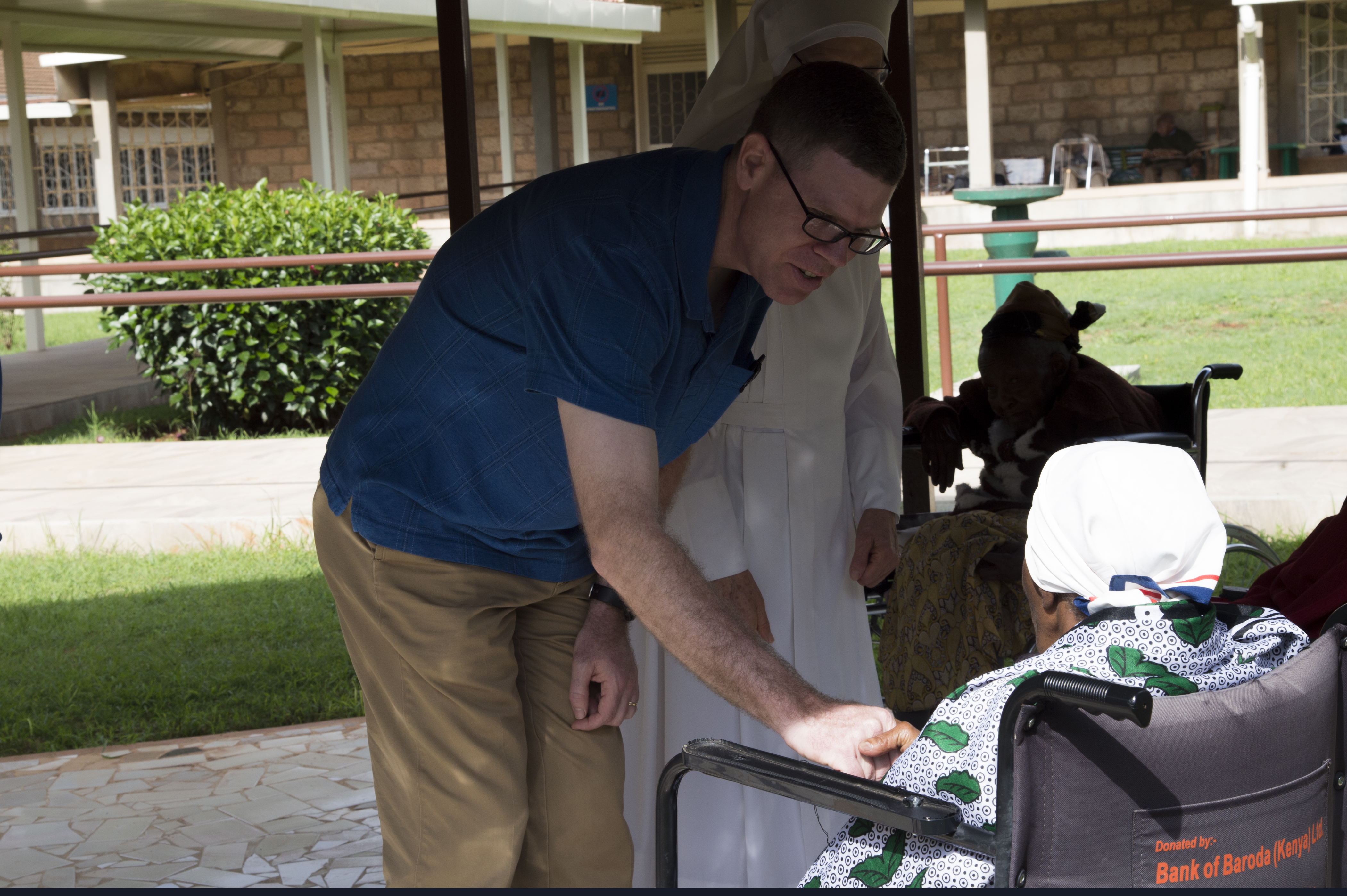 U.S. Navy Chaplain Travis Moger, Combined Joint Task Force-Horn of Africa Office of Religious Affairs director, provides spiritual counseling to a resident of Nyumba Ya Wazee, or House of the Elderly, May 9, 2016, at Nairobi, Kenya. The House of the Elderly is a part of the Little Sisters of the Poor, a non-profit organization that provides shelter and support for people who need assistance. (U.S. Air Force photo by Staff Sgt. Eric Summers Jr.)