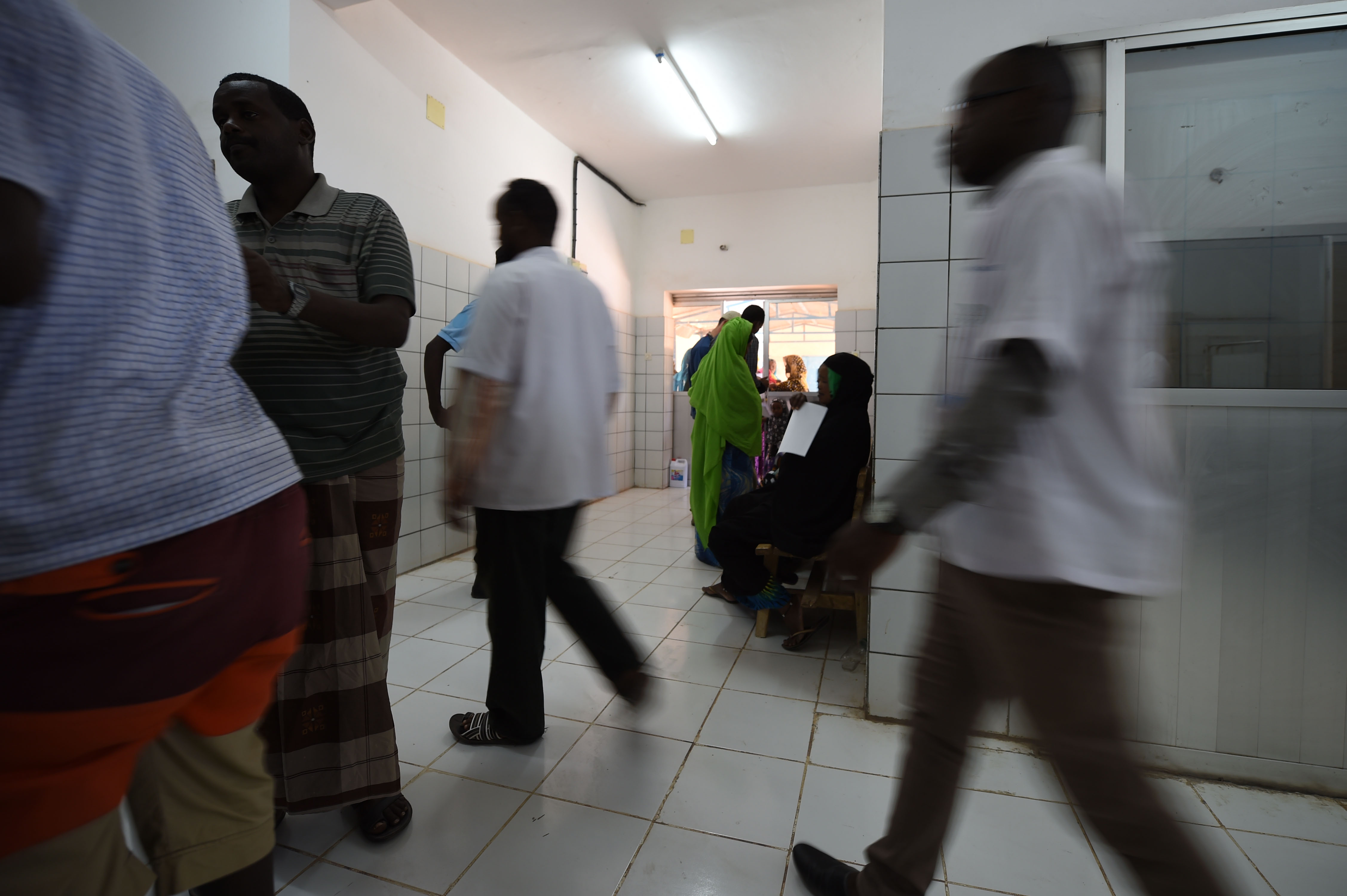 DIKHIL, Djibouti – Members from the 403rd Civil Affairs Battalion, Djibouti Ministry of Health and Cuban medical personnel work together to treat approximately 119 people during the two-day medical civic action program at Dikhil, Djibouti, May 11, 2016. The medical teams spent a total of 10 hours with patients treating a variety of illnesses with women, children and men of all ages. (U.S. Air Force photo by Staff Sgt. Tiffany DeNault)