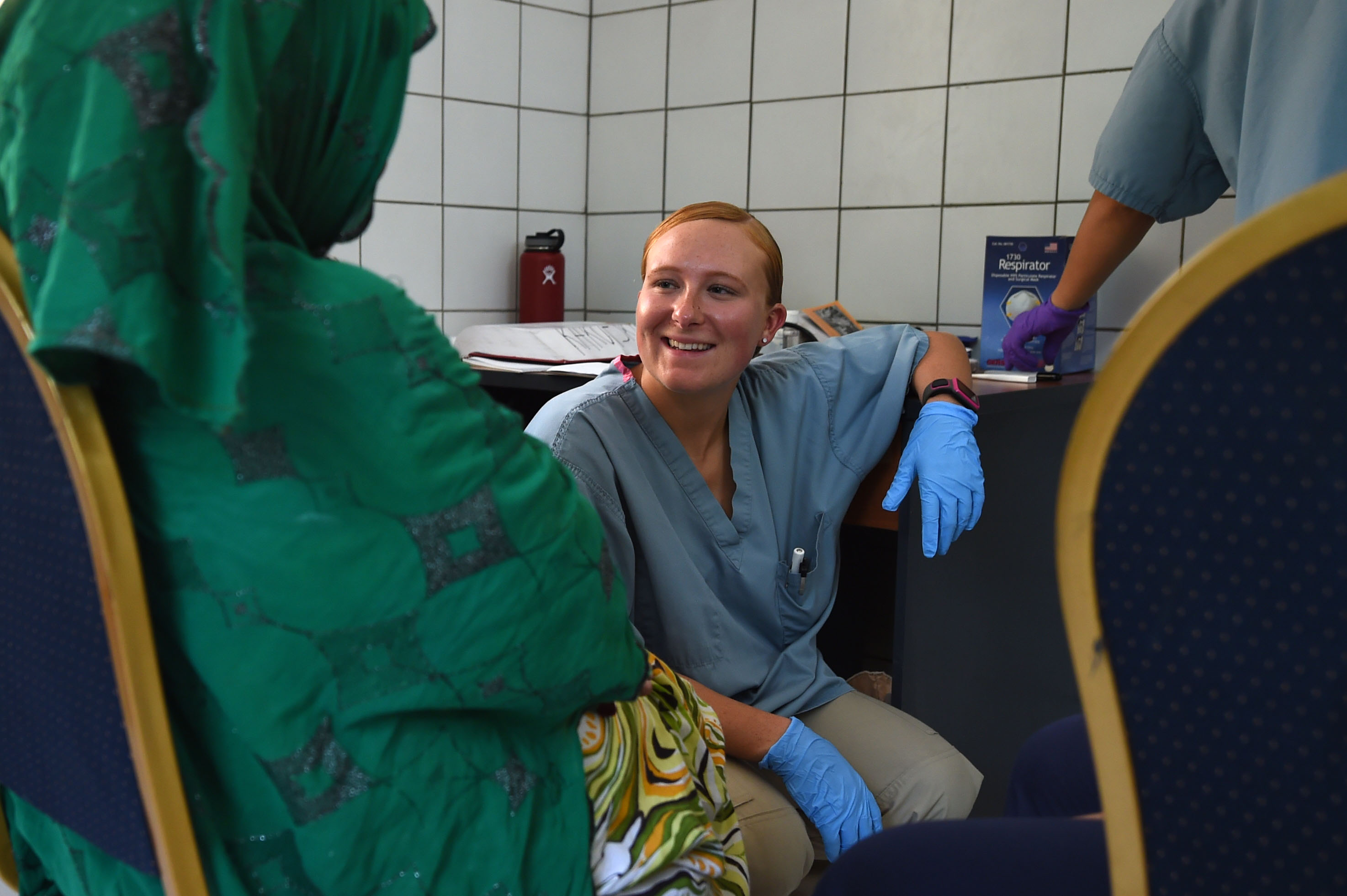 DIKHIL, Djibouti – U.S. Army Spc. Kristie Richardson, 403rd Civil Affairs Battalion medical assistant, completes a health assessment to patients during a medical civic action program at Dikhil, Djibouti, May 11, 2016. The MEDCAP brought together the 403rd CA BN with the Djibouti Ministry of Health and Cuban medical personnel for a two-day event to provide medical care and education. (U.S. Air Force photo by Staff Sgt. Tiffany DeNault)