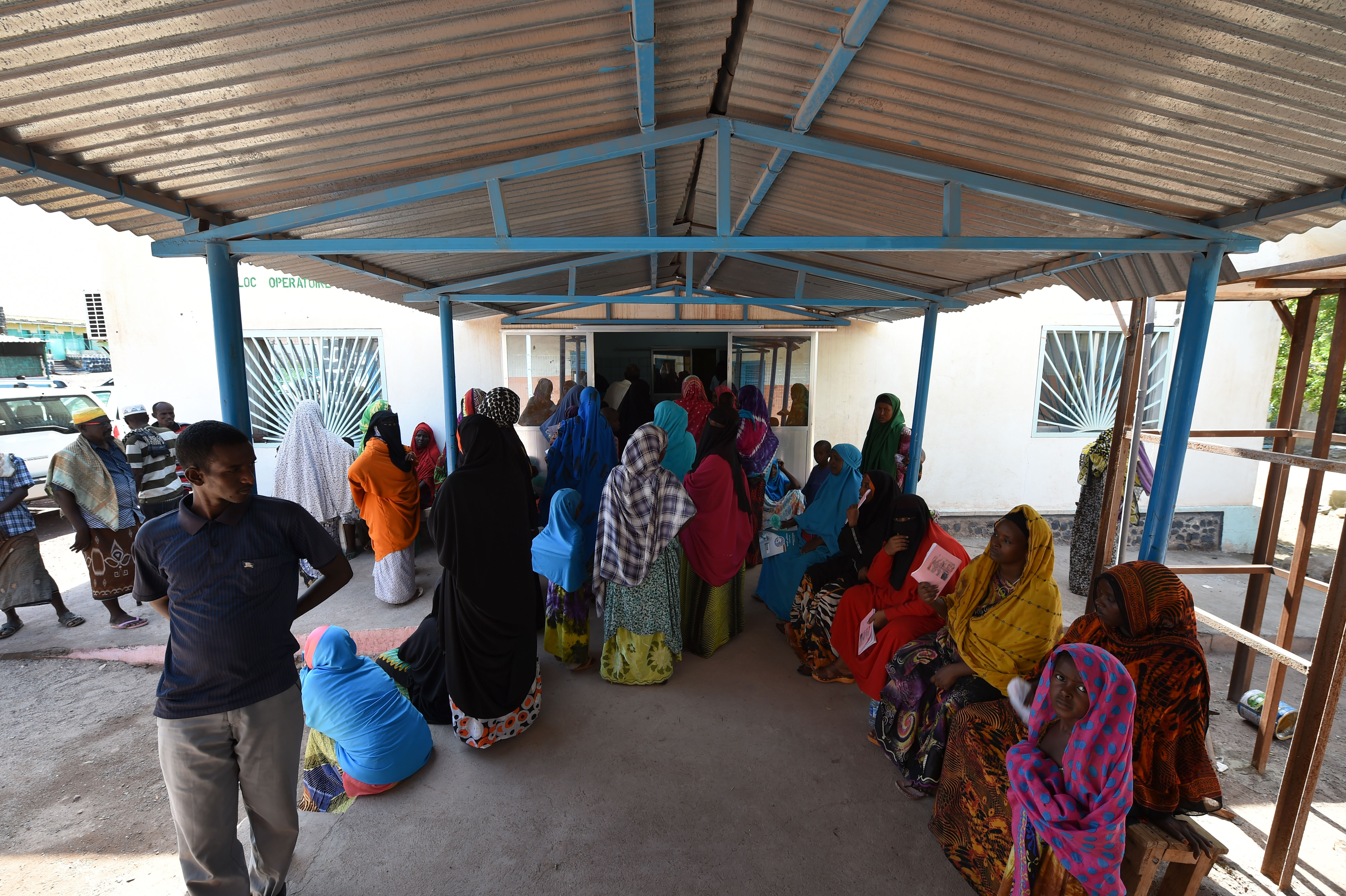 DIKHIL, DJIBOUTI – Villagers of Dikhil, Djibouti, wait to be seen by medical professionals from the 403rd Civil Affairs Battalion, Djibouti Ministry of Health and Cuban medical personnel during a medical civic action program, May 11, 2016. During the two-day program, MEDCAP offers medical care, medication and education to patients and allows the medical teams to work and exchange medical knowledge. (U.S. Air Force photo by Staff Sgt. Tiffany DeNault)