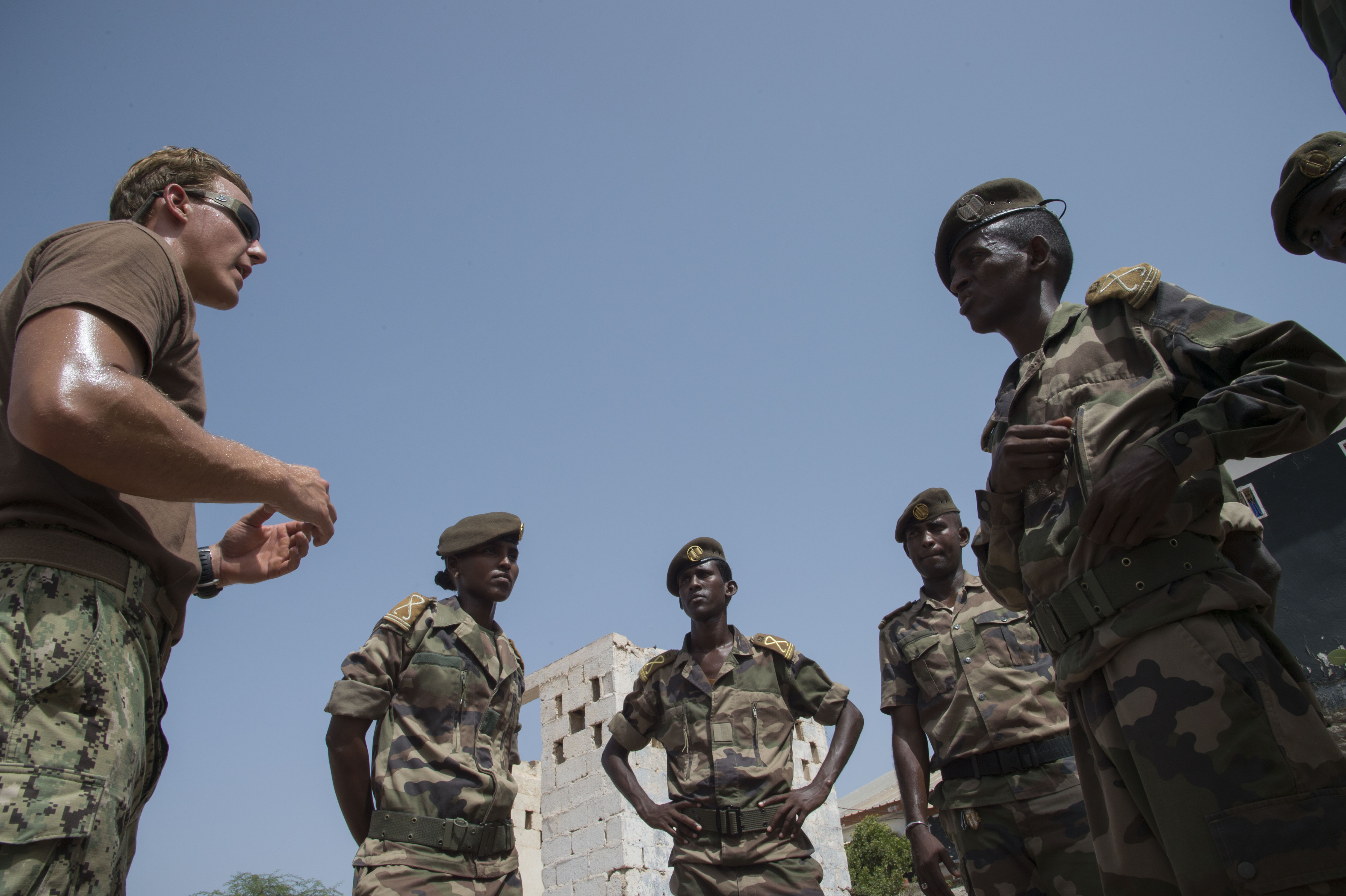 U.S. Navy Petty Officer 2nd Class Evan Bruce, a Mobile Unit 1 explosive ordnance disposal technician, evaluates Djiboutian Army cadets on their roadside bomb patrol during a training course at Arta, Djibouti, May 18, 2016. Cadets who become officers may perform missions in Somalia keeping troops safe from roadside bombs. (U.S. Air Force photo by Staff Sgt. Eric Summers Jr./Released)