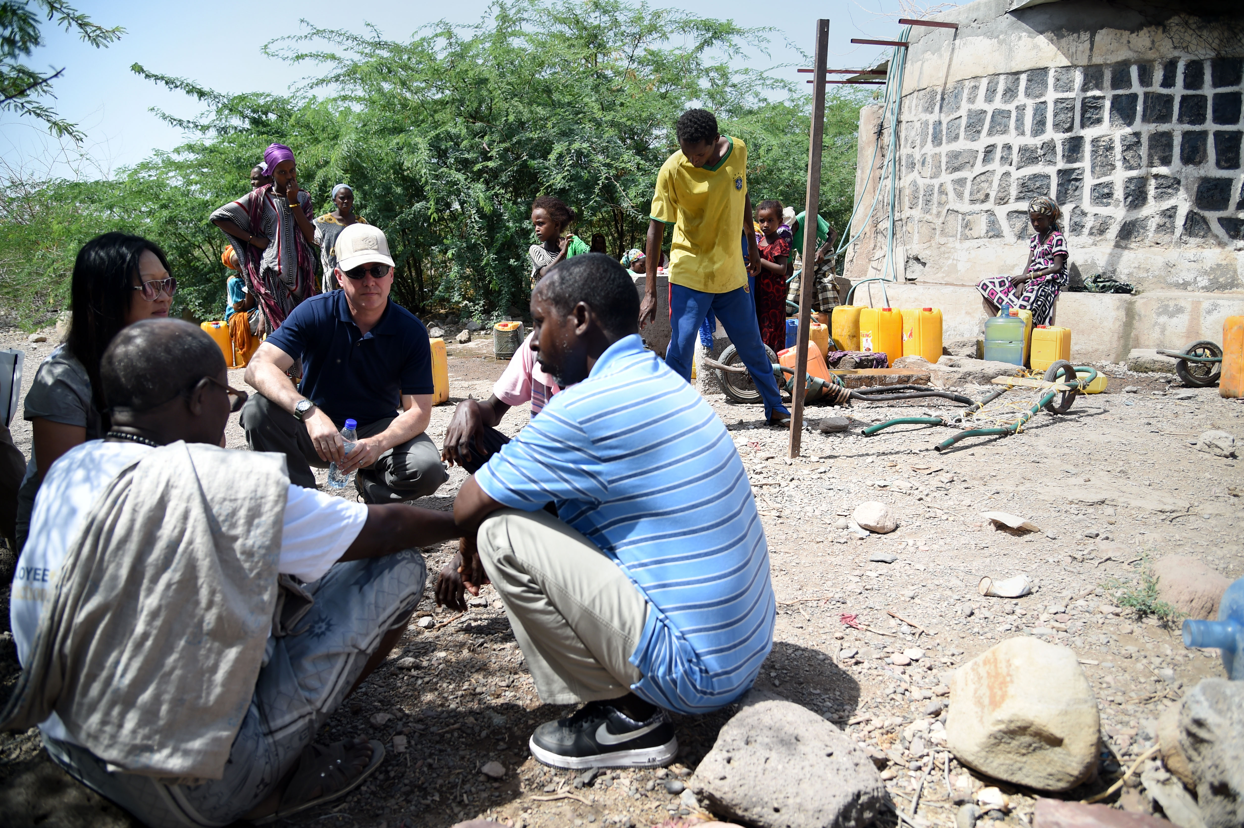 KALAF, Djibouti – Members of the Combined Joint Task Force-Horn of Africa J44 Force Engineers met with village elders to determine what improvements needed to be made to the community water cistern and well, May 17, 2016, in Kalaf, Djibouti. U.S. Navy Cmdr. Chris Myers and Lt. Trang Tieu, CJTF-HOA J44 Force Engineers, and Abdi Ali, translator and guide, talked with the village elders and measured the water level in the well to help determine the community needs. (U.S. Air Force photo by Staff Sgt. Tiffany DeNault)