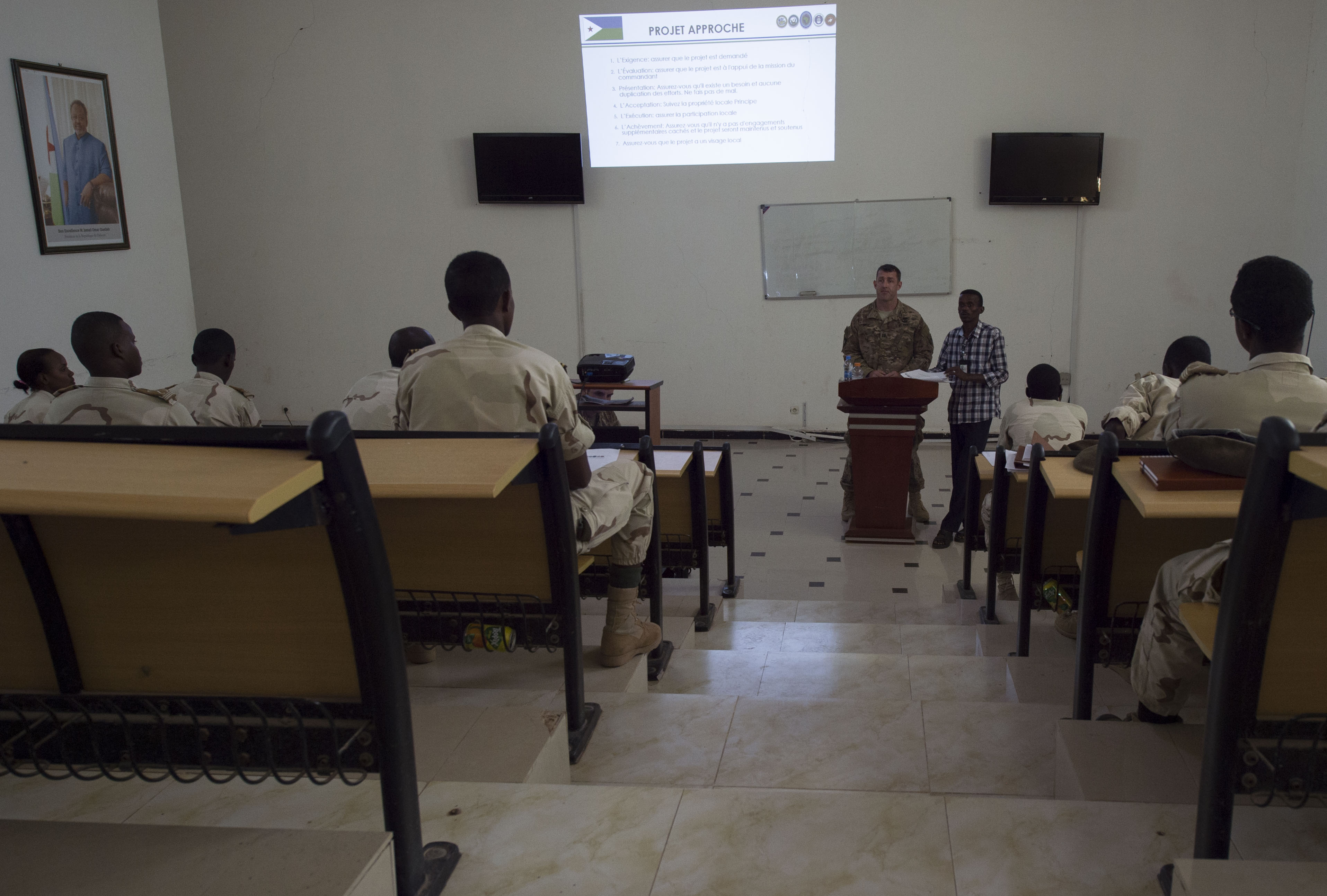 U.S. Army Capt. Scott Wyly, 403rd Civil Affairs Battalion team leader, teaches Djibouti's Arta Interservices Military Academy cadets how to interact with host nation civilians in areas of conflict May 17, 2016, at Arta, Djibouti.  The third-year cadets are scheduled to graduate in September and have the possibility of deploying to Somalia after a year. (U.S. Air Force photo by Staff Sgt. Eric Summers Jr.)