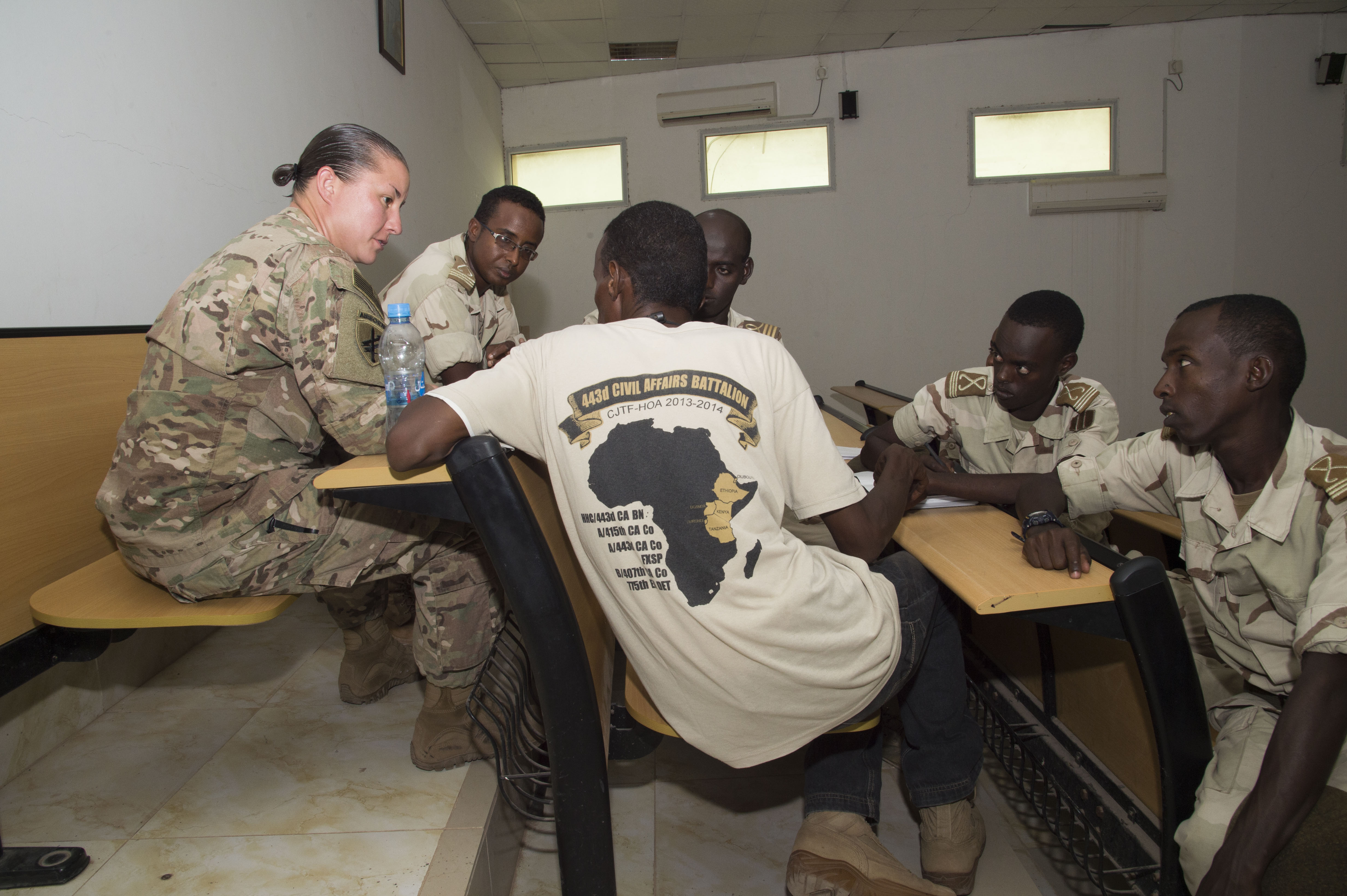 Sgt. 1st Class Cynthia Price, 403rd Civil Affairs instructor, provides feedback to Djibouti's Arta Interservices Military Academy cadets during Civil Military Cooperation training May 18, 2016, at Arta, Djibouti. The feedback educated the cadets on their strengths and weaknesses during training scenarios to better prepare them for the next task. (U.S. Air Force photo by Staff Sgt. Eric Summers Jr.)