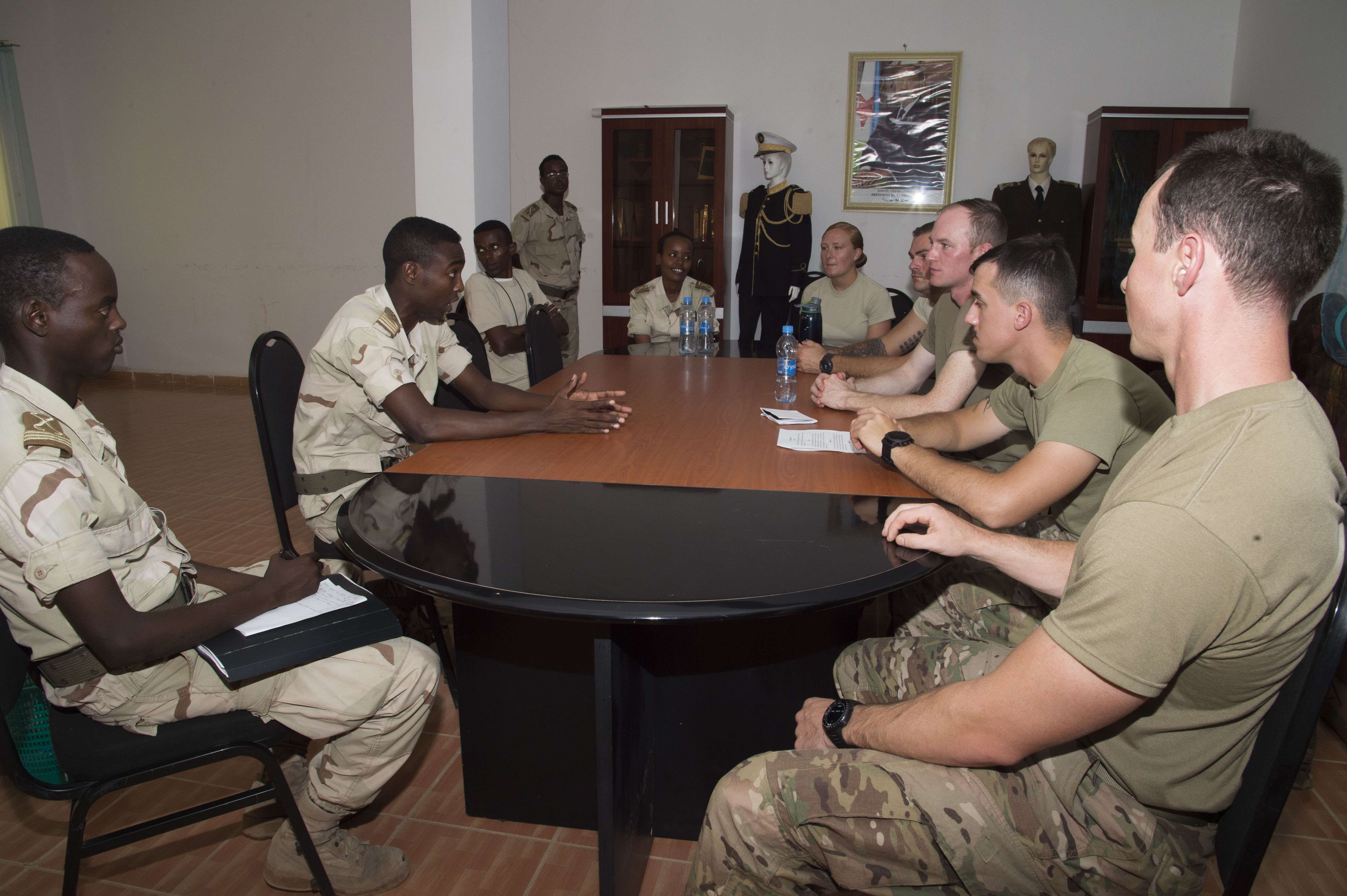 Djibouti's Arta Interservices Military Academy cadets engage in conversation with U.S. Army 403rd Civil Affairs members acting as Somali key leaders during a training scenario May 18, 2016, at Arta, Djibouti. The Civil Affairs team taught the cadets a variety of skills to include how to conduct meetings, key leader engagements and proper use of interpreters. (U.S. Air Force photo by Staff Sgt. Eric Summers Jr.)