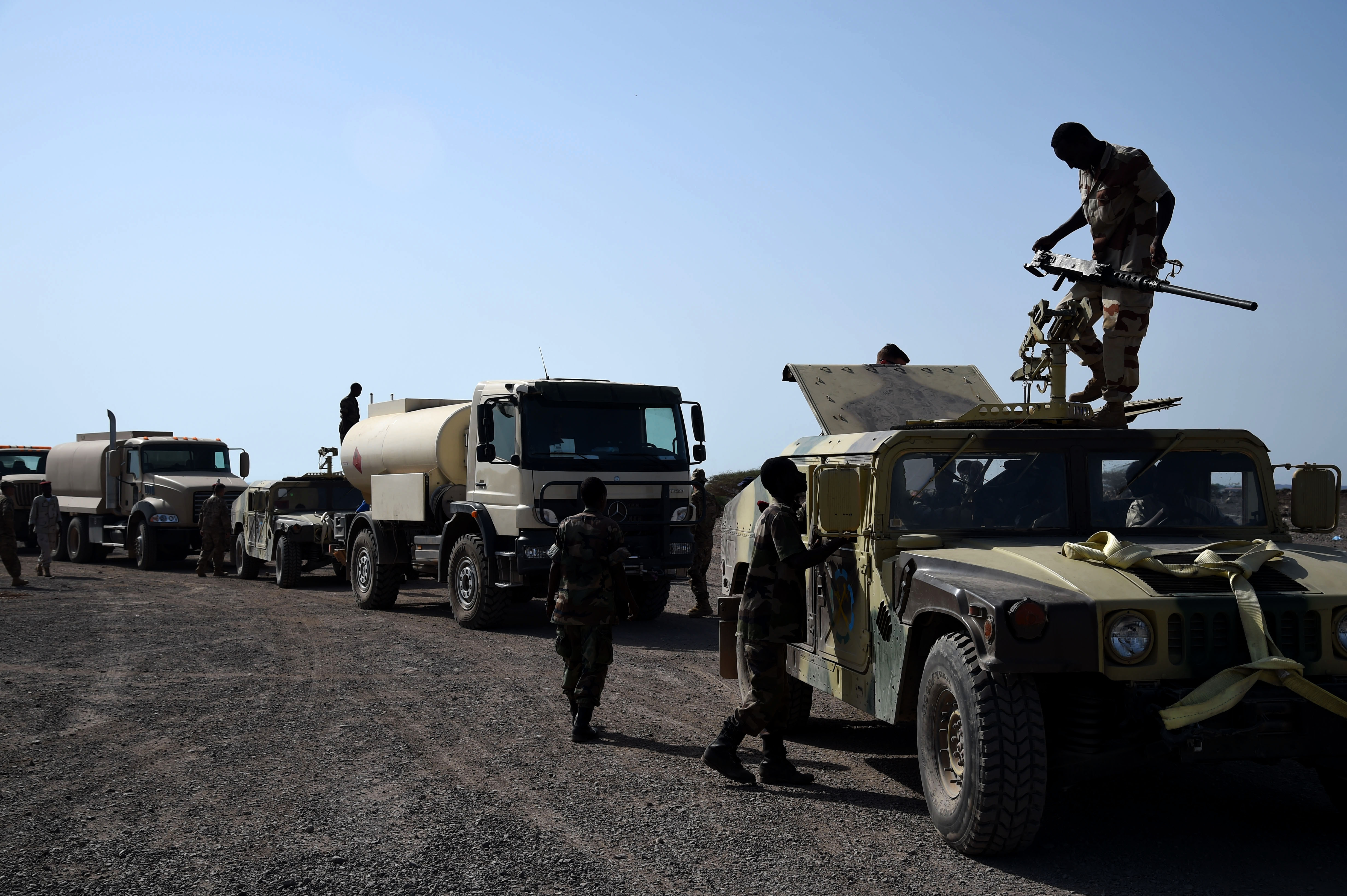 CAMP CHEIK OSMAN, Djibouti – Djiboutian Armed Forces (FAD) Soldiers prepare their convoy for the final test after completing a five-month training course instructed by the U.S. Army Regionally Aligned Forces Soldiers, May 16, 2016, at Camp Cheik Osman, Djibouti. The three-phased training was completed demonstrating their reactions to various mock situations from convoying through a road block, identifying mock roadside bombs, medical care, and vehicle recovery. (U.S. Air Force photo by Staff Sgt. Tiffany DeNault)
