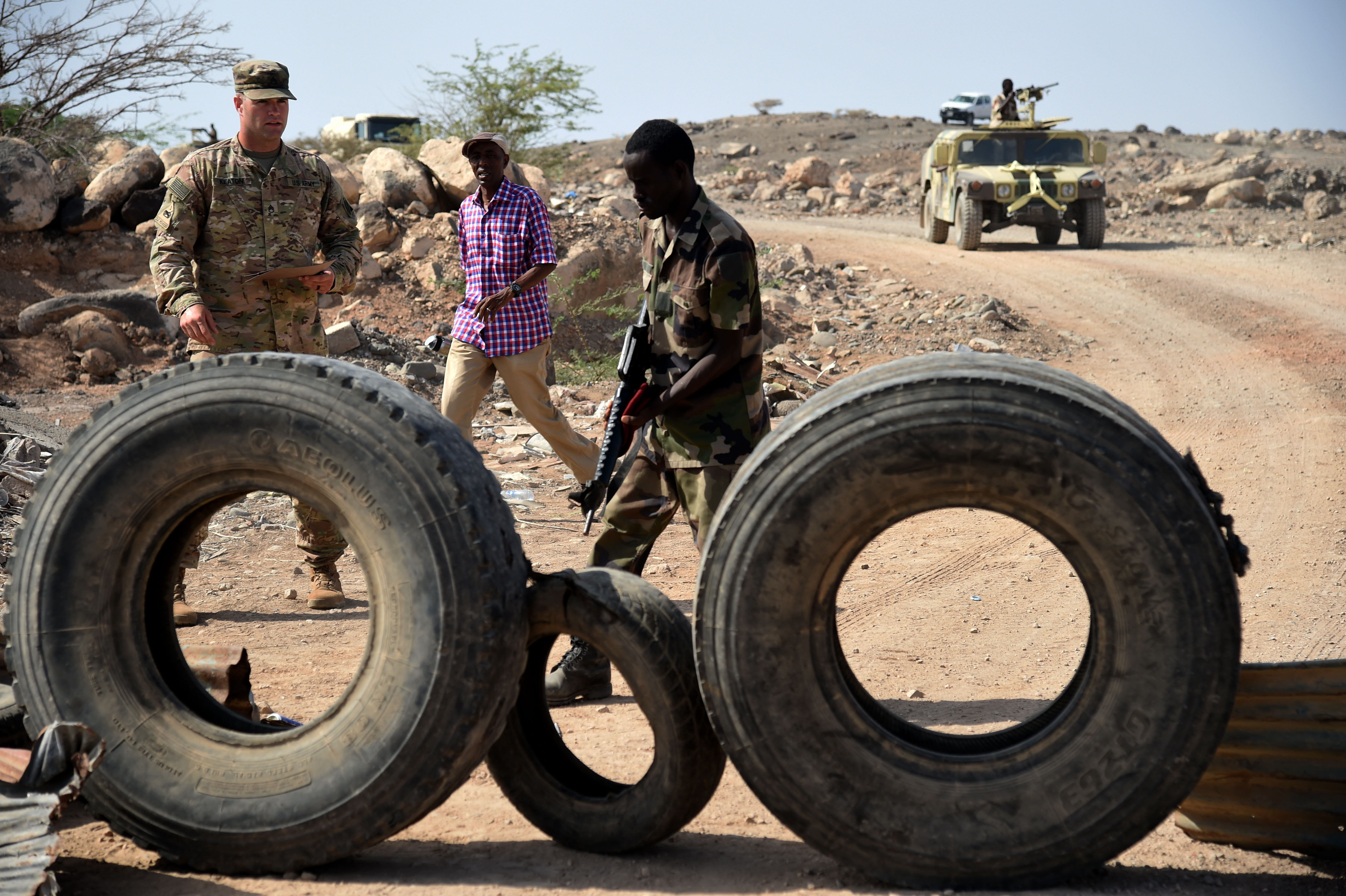 CAMP CHEIK OSMAN, Djibouti – U.S. Army Staff Sgt. Richard Keaton, U.S. Army Regionally Aligned Forces instructor, tests a Djiboutian Armed Forces (FAD) soldier on identifying a mock roadside bomb during a road block test, May 16, 2016, at Camp Cheik Osman, Djibouti. The USARAF spent approximately five months with FAD soldiers training them on various combat skills from medical care, rifle marksmanship, improvised explosive device recognition, convoy procedures and more. (U.S. Air Force photo by Staff Sgt. Tiffany DeNault)