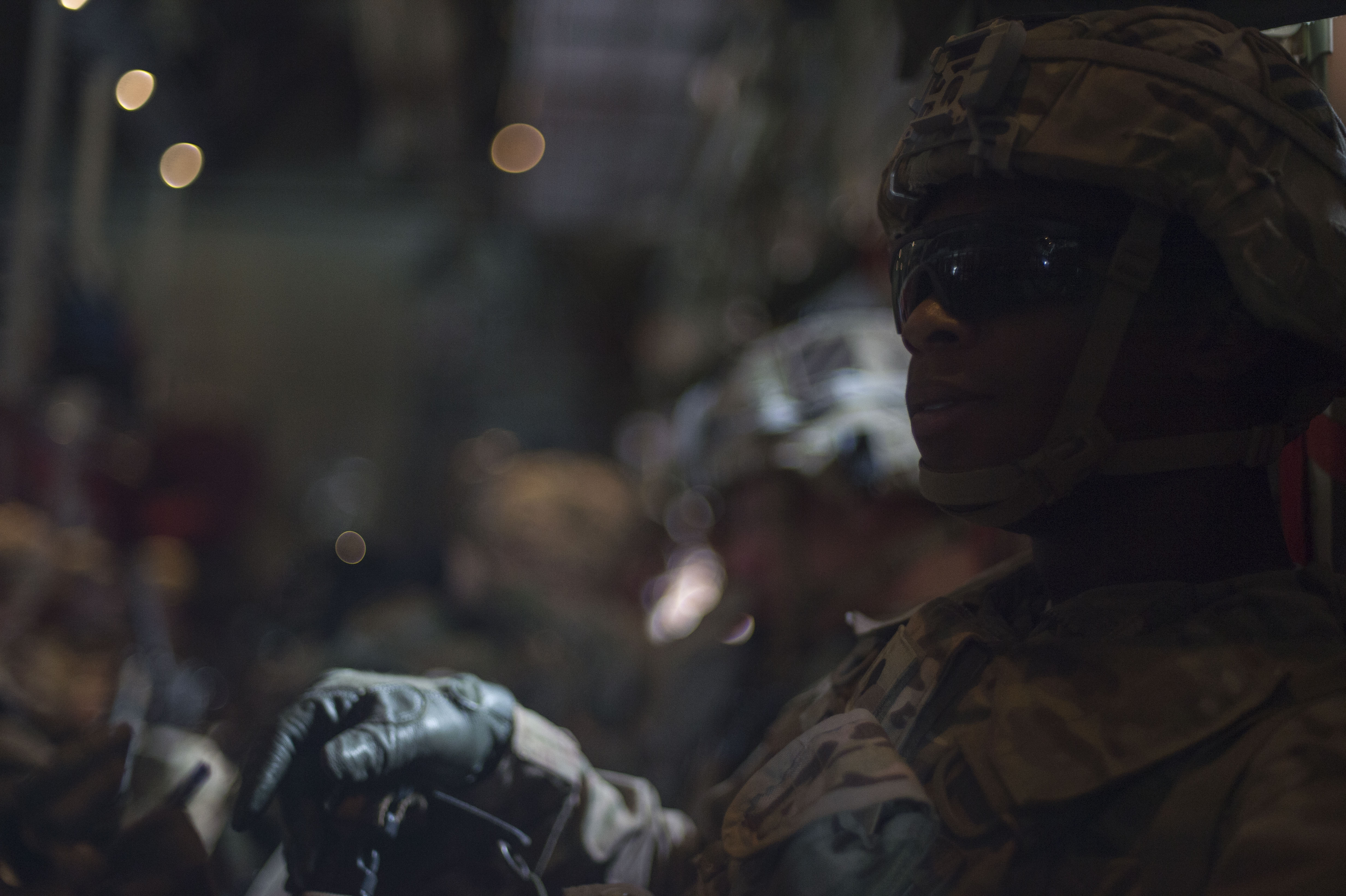 U.S. Army Spc. Kenneth Cook, of the East African Response Force, sits inside a U.S. Air Force C-130J Hercules while awaiting transport during an EARF validation exercise, May 27, 2016, at Camp Lemonnier, Djibouti. Combined Joint Task Force-Horn of Africa planned and executed the validation after  1st Battalion, 124th Infantry Regiment, or Task Force Hurricane, from Miami, Fla., assumed responsibility of the EARF mission from 2nd Battalion, 124th Infantry Regiment, or Task Force Seminoles, who will return to Orlando, Fla. (U.S. Air Force photo by Staff Sgt. Eric Summers Jr.)