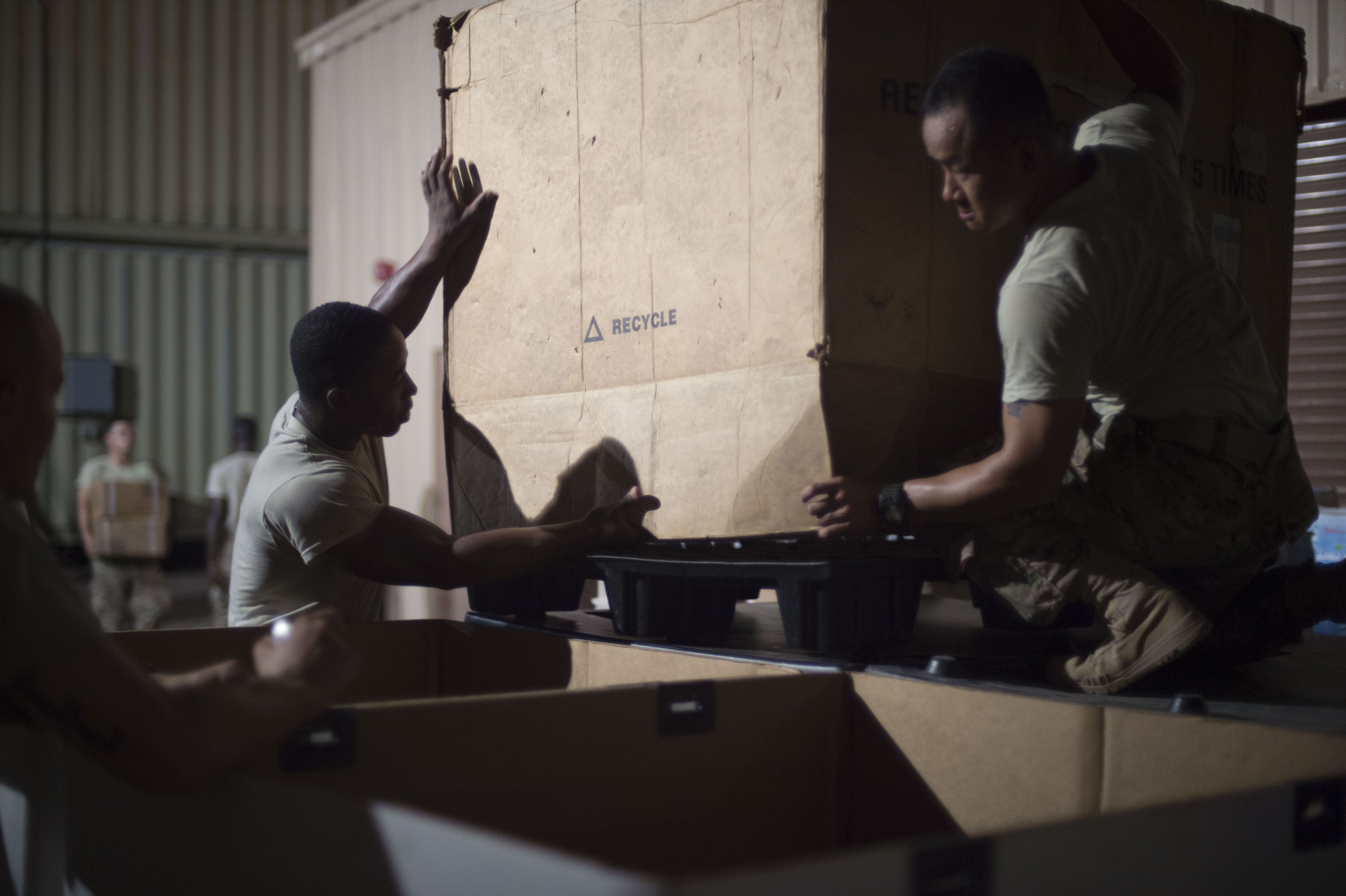 U.S. Army Cpl. Lavon Smith and Spc. Tien Do, East African Response Force members, build pallets to store supplies and equipment during an EARF validation exercise May 27, 2016, at Camp Lemonnier, Djibouti. The pallets containing tons of sustainment items were loaded for transport on to a U.S. Air Force C-130J Hercules aircraft. (U.S. Air Force photo by Staff Sgt. Eric Summers Jr.)