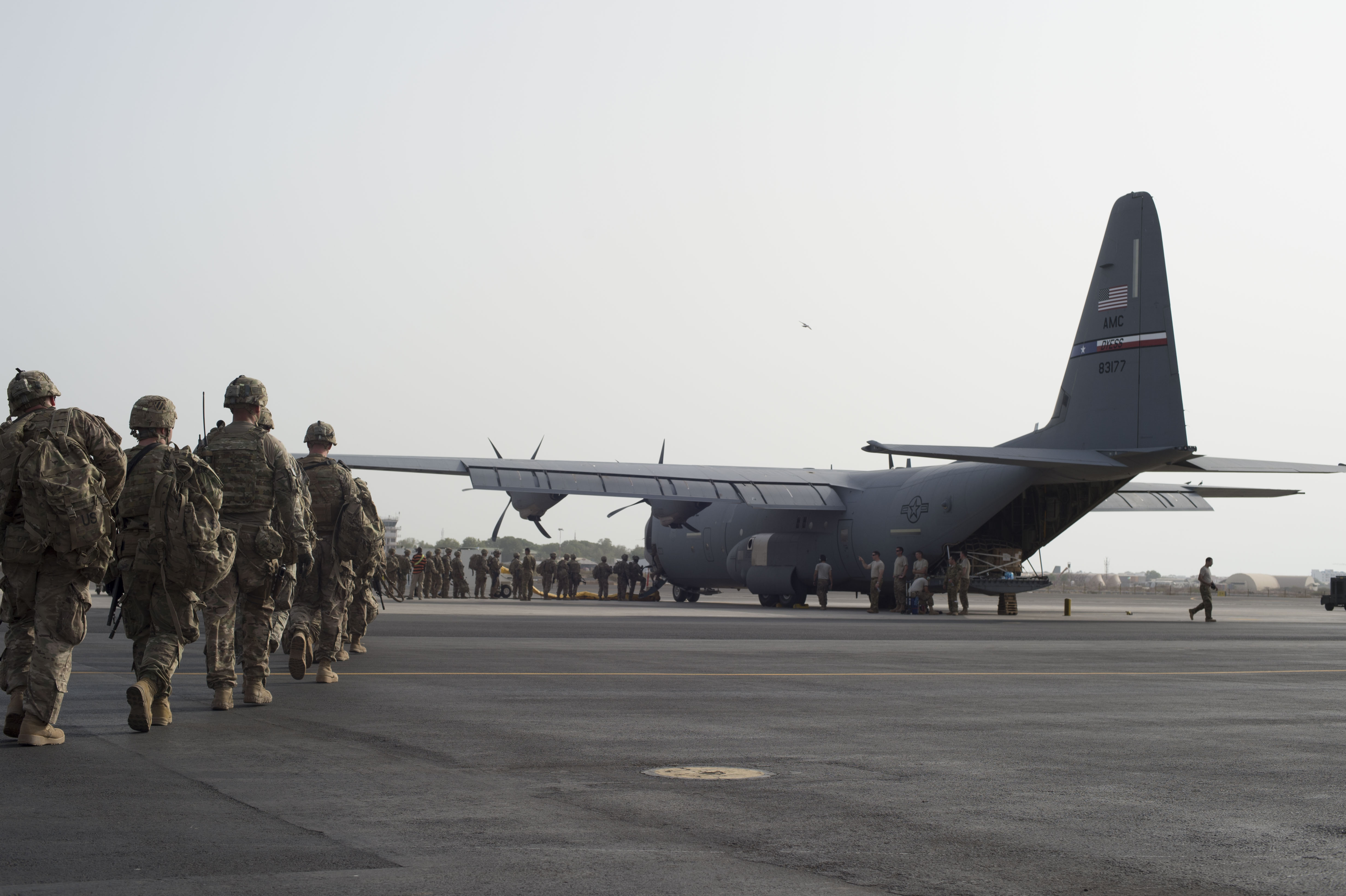 Tons of cargo and passengers are loaded on to a U.S. Air Force C-130J Hercules during an East African Response Force validation exercise May 27, 2016, at Camp Lemonnier, Djibouti. The mission of the EARF is to provide rapidly deployable assets at a moment's notice to reinforce embassies within the Combined Joint Task Force-Horn of Africa area of responsibility. (U.S. Air Force photo by Staff Sgt. Eric Summers Jr.)