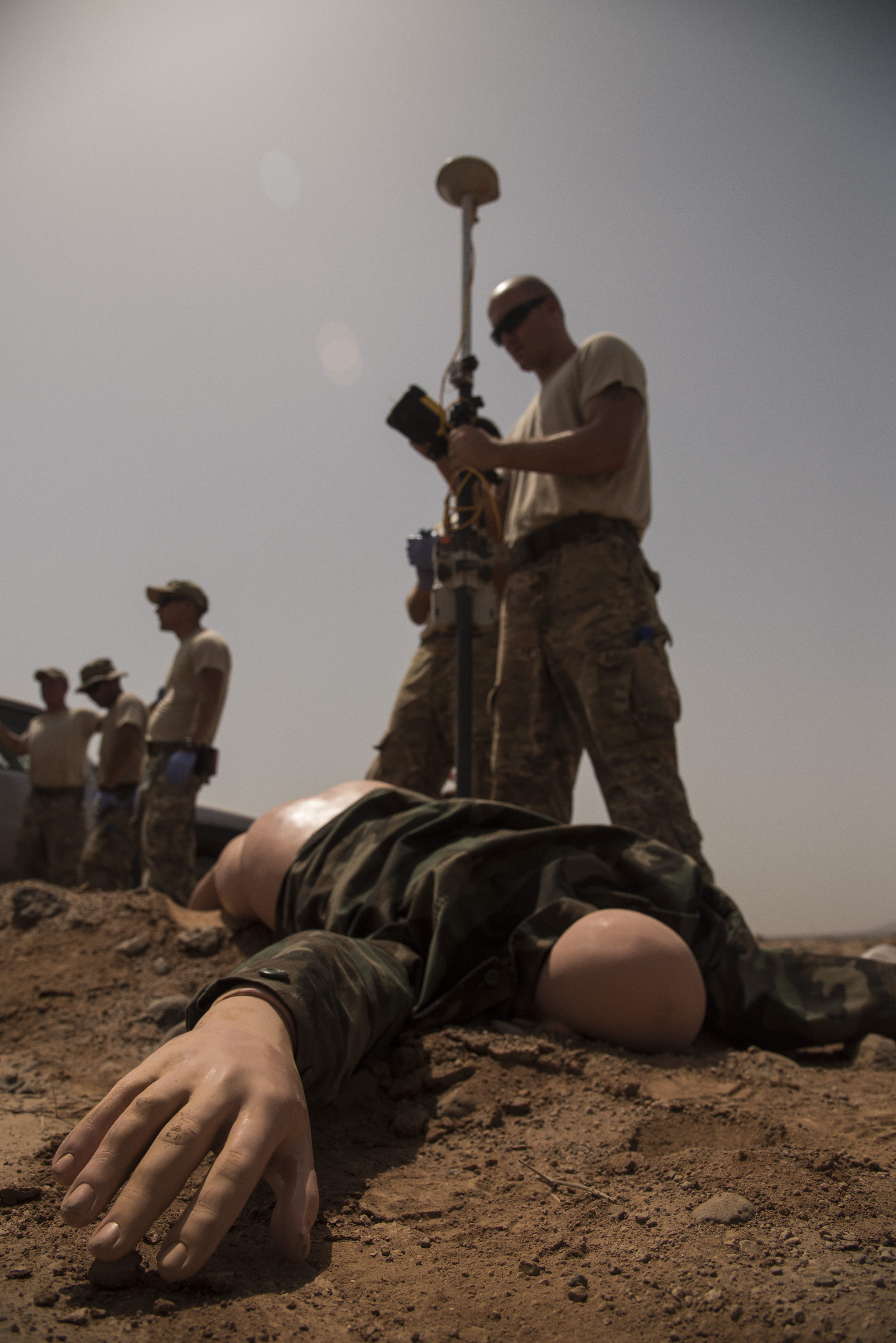 DJIBOUTI- U.S. Air Force Master Sgt. Jason McNabb, 870th Air Expeditionary Squadron Services, records the location of a mock casualty during a mass casualty exercise, June 1, 2016, at nearby airfield. The exercise involved personnel from Chabelley Airfield, Camp Lemonnier, and Combined Joint Task Force-Horn of Africa to test their skills in search and recovery, communication, coordination and mortuary affairs collection point processes. (U.S. Air Force photo by Staff Sgt. Tiffany DeNault)
