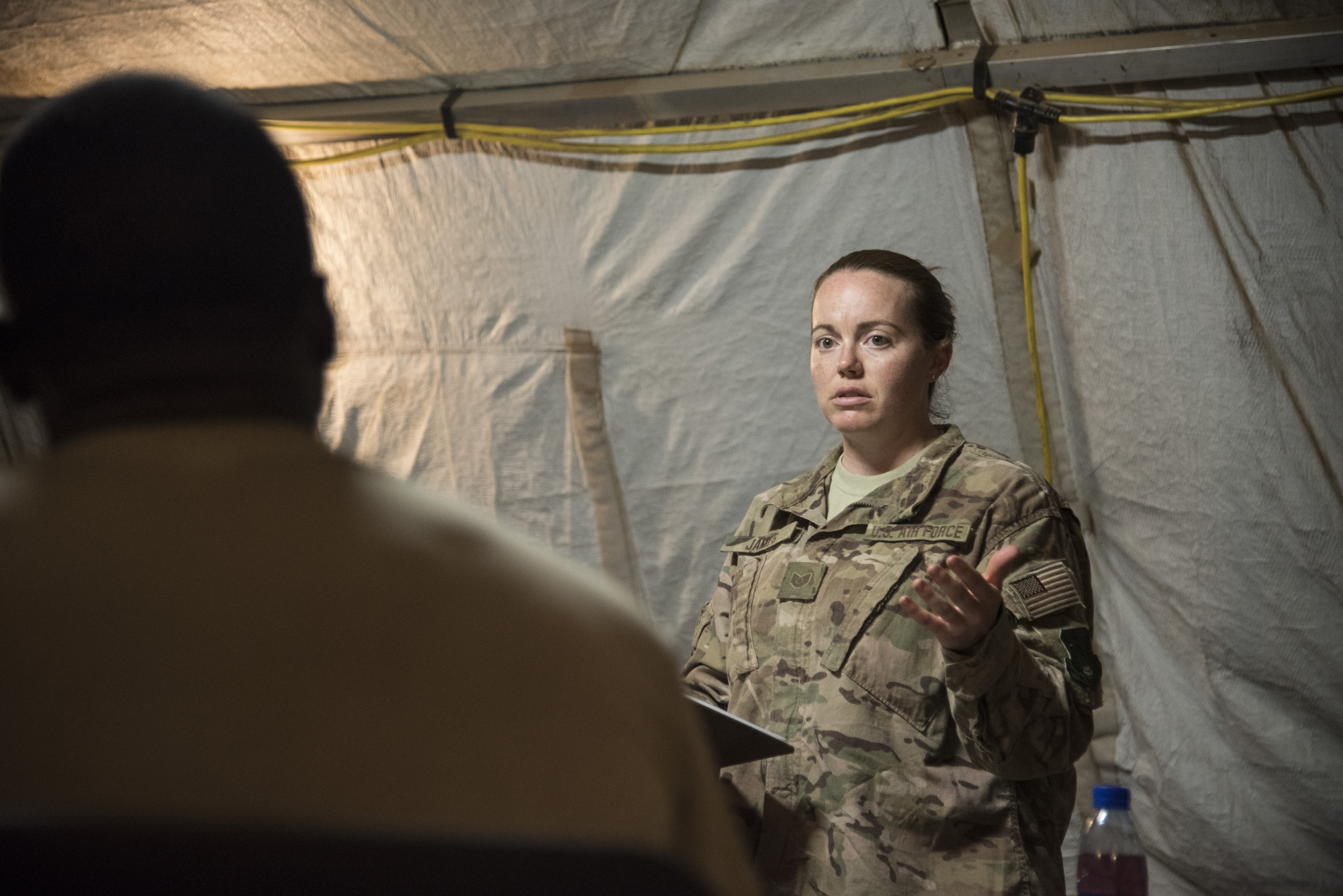 DJIBOUTI- U.S. Air Force Tech. Sgt. Kacy James, 870th Air Expeditionary Squadron Services and Mass Casualty Exercise team lead, briefs her team on the exercise scenario and search and recovery processes during a mass casualty exercise, June 1, 2016. The exercise included mortuary affairs personnel and volunteers from the U.S. Air Force, Navy, Marine Corps and Army, testing their communication, coordination, and skills in search and recovery and mortuary affairs collection point processes. (U.S. Air Force photo by Staff Sgt. Tiffany DeNault)