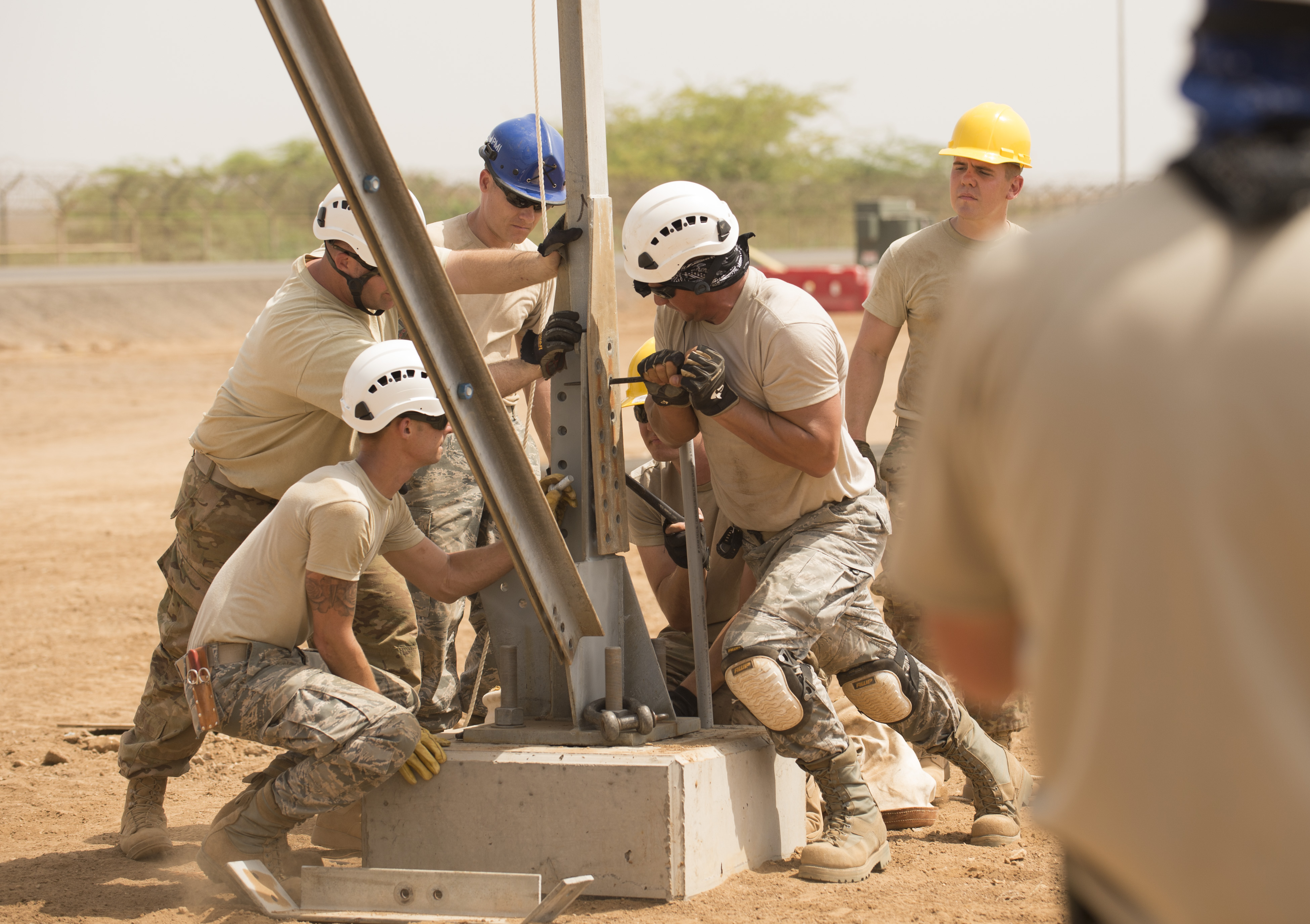 CAMP LEMONNIER, Djibouti- U.S. Air Force Airmen of the 205th Engineering Installation Squadron, out of Oklahoma City, line up pieces of the metal frame during construction of an AN/GPN-27 Airport Surveillance Radar System tower, May 26, 2016, at Camp Lemonnier, Djibouti. The new radar is a more permanent replacement for the short-term radar currently in operation. (U.S. Air Force photo by Staff Sgt. Tiffany DeNault)