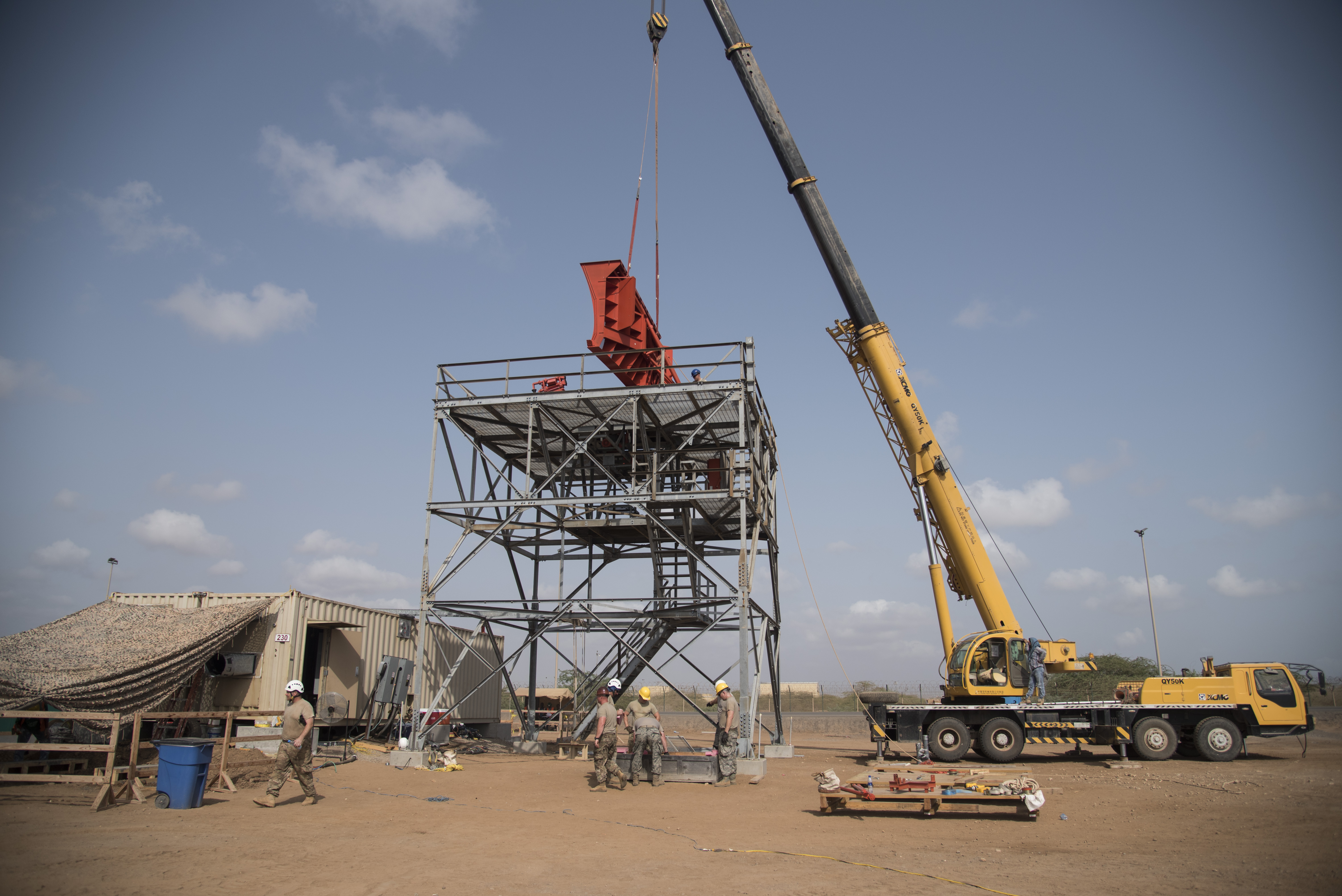 CAMP LEMONNIER, Djibouti- U.S. Air Force Airmen of the 205th Engineering Installation Squadron, out of Oklahoma City install a new AN/GPN-27 Airport Surveillance Radar System tower, June 4, 2016, at Camp Lemonnier, Djibouti. With coordination between the 205th EIS, U.S. Air Forces in Europe, U.S. Air Force Flight Standards Agency, U.S. Air Forces Central Command and the U.S. Navy, the new radar will increase air traffic control capabilities and safety. (U.S. Air Force photo by Staff Sgt. Tiffany DeNault)
