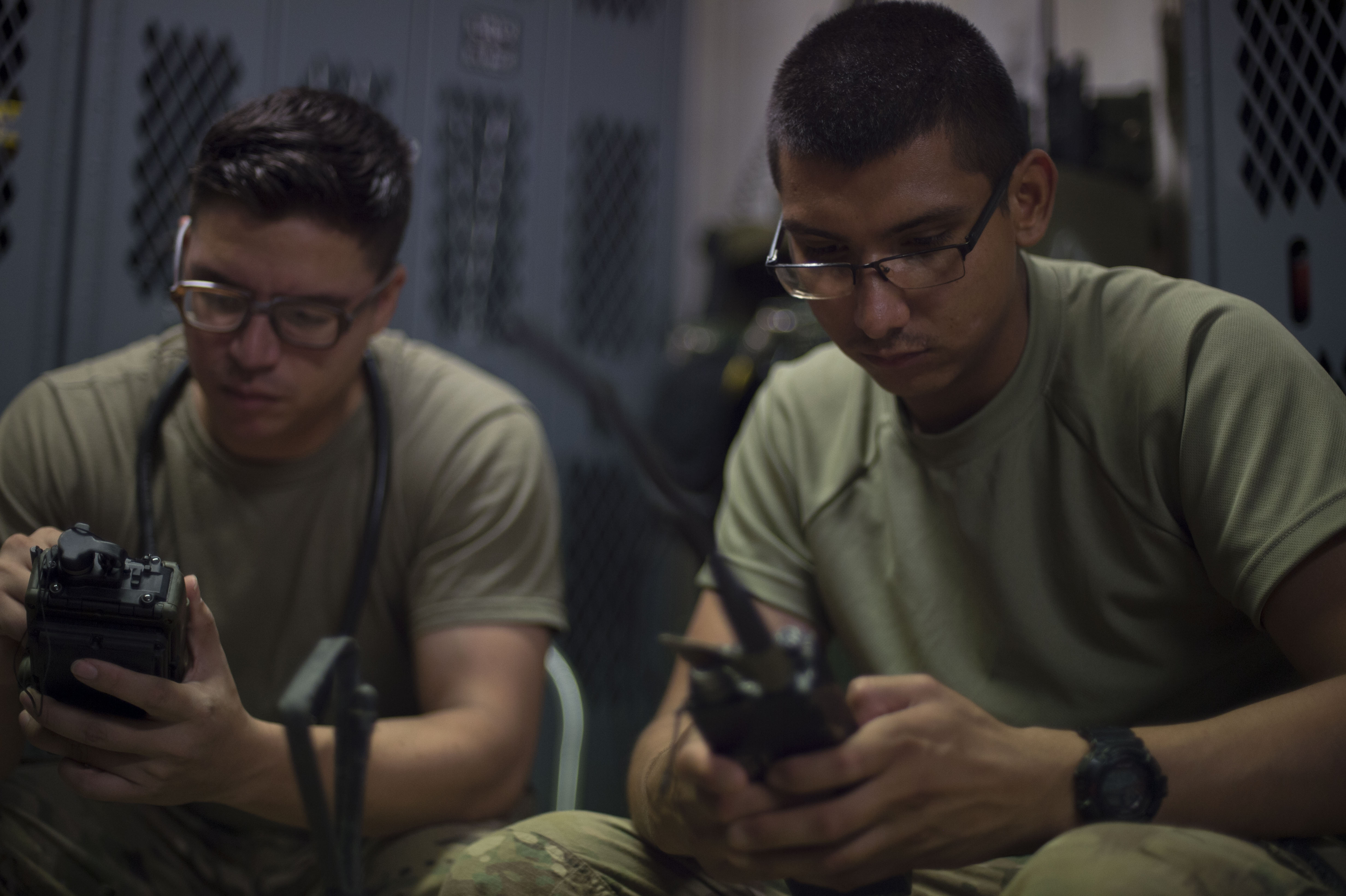 U.S. Army Sgt. Gary Mendieta and Pfc. Michael Umanzor, Combined Joint Task Force-Horn of Africa Quick Reaction Force team members, calibrate radios June 20, 2016, at Camp Lemonnier Djibouti. Umanzor, a native of Lake Worth, Fla., and Mendieta, a native of Boynton Beach, Fla., are a part of the 1st Battalion, 124th Infantry Regiment that assumed the QRF mission in May. (U.S. Air Force photo by Staff Sgt. Eric Summers Jr.)