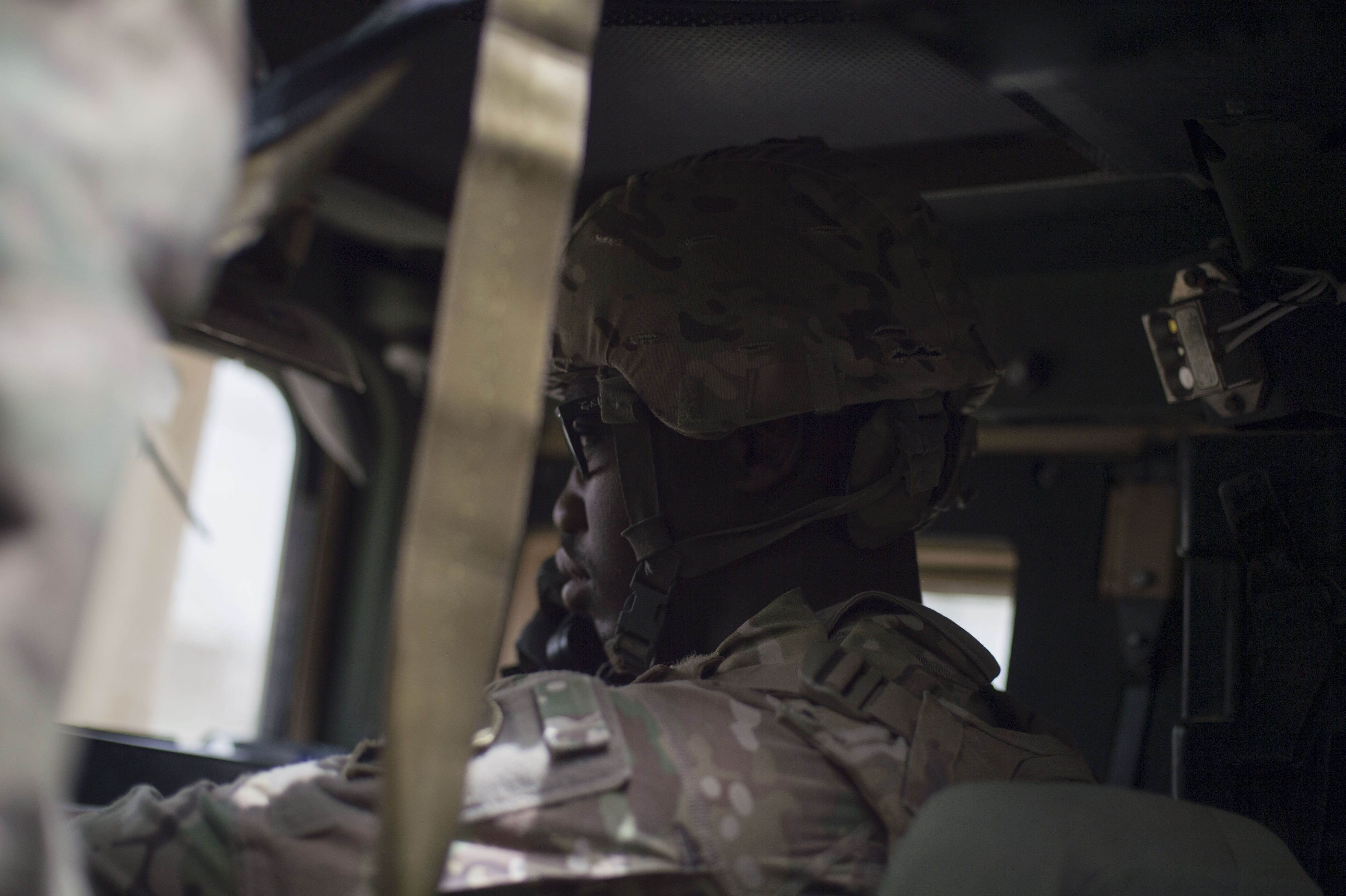 U.S. Army Spc. Vital Dieujuste, Combined Joint Task Force-Horn of Africa Quick Reaction Force team member, communicates with the lead vehicle during a mission June 20, 2016, at Camp Lemonnier, Djibouti. Dieujuste is a native of Palm Beach, Fla. (U.S. Air Force photo by Staff Sgt. Eric Summers Jr.)